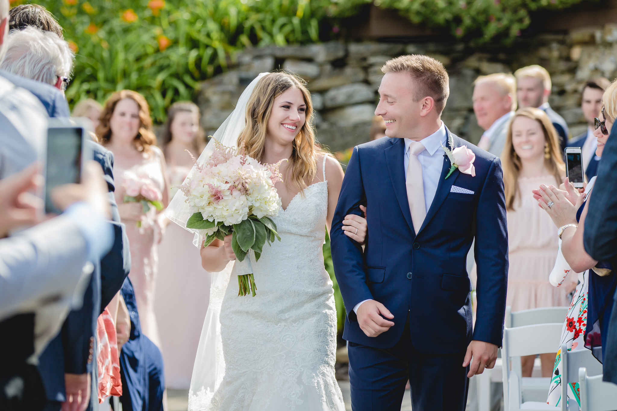 Newlyweds leaving their wedding ceremony at Hidden Valley Resort