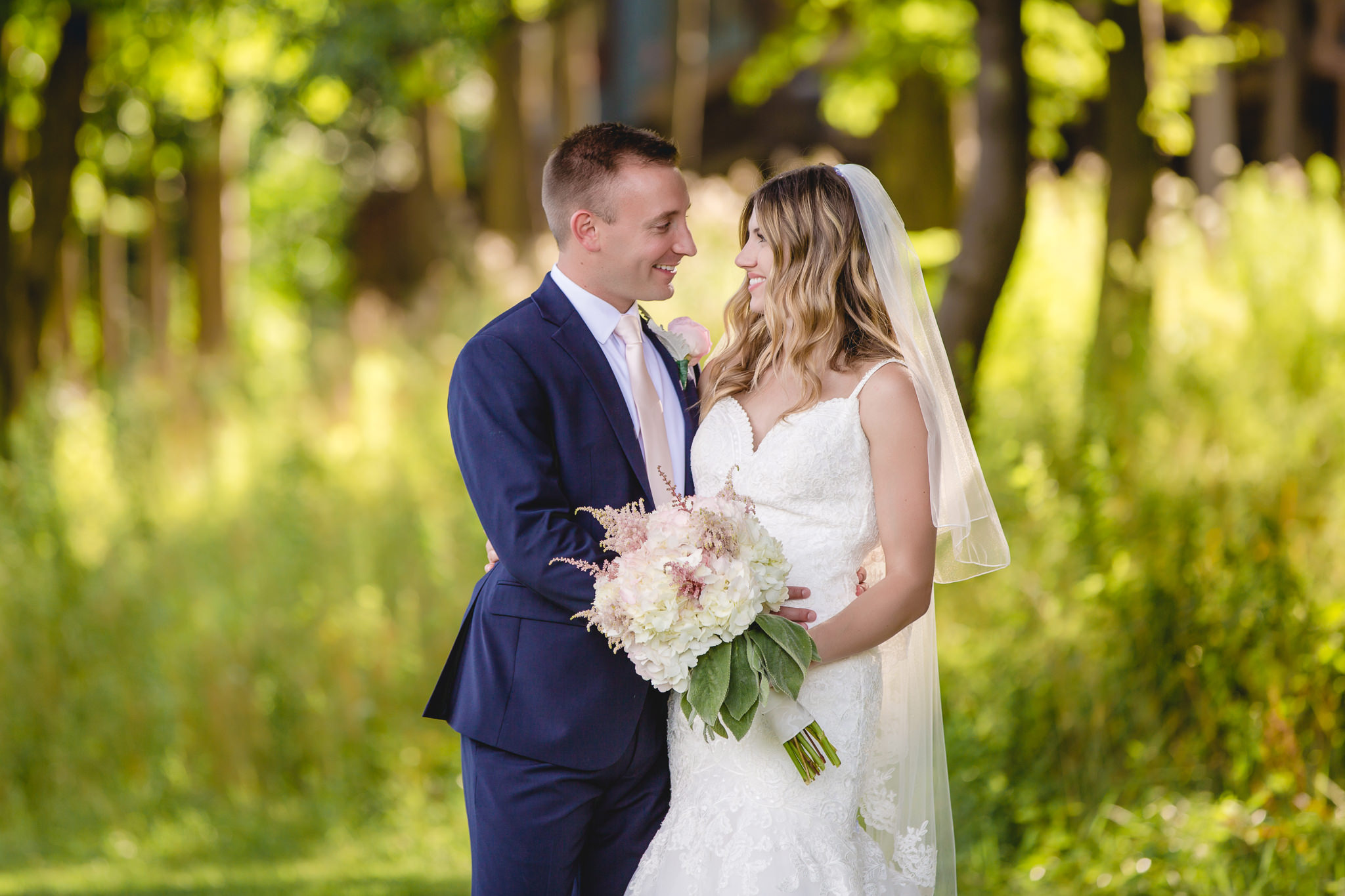 Bride and groom pose for portraits at Hidden Valley Resort