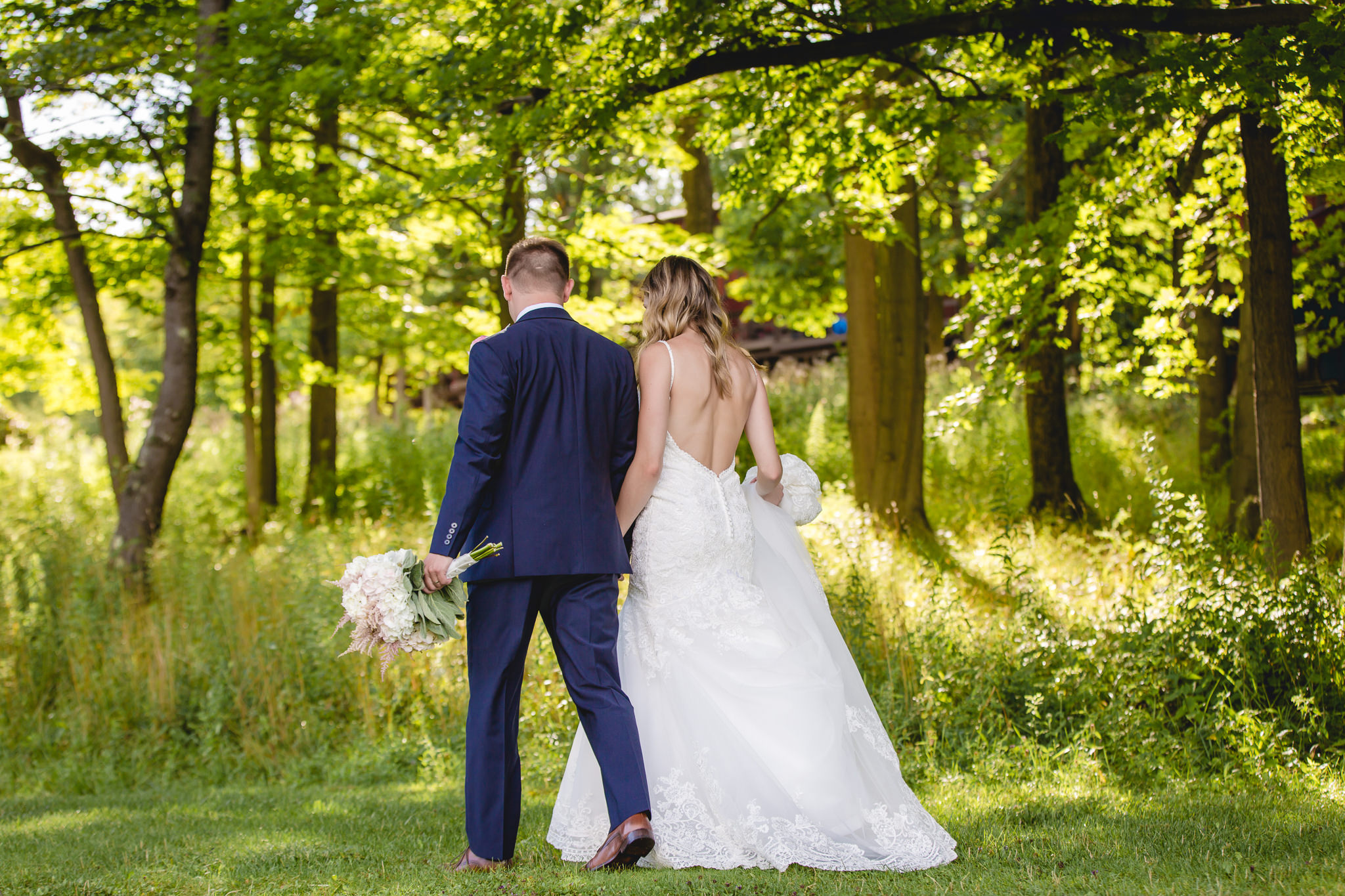 Newlyweds take a stroll after their ceremony at Hidden Valley Resort