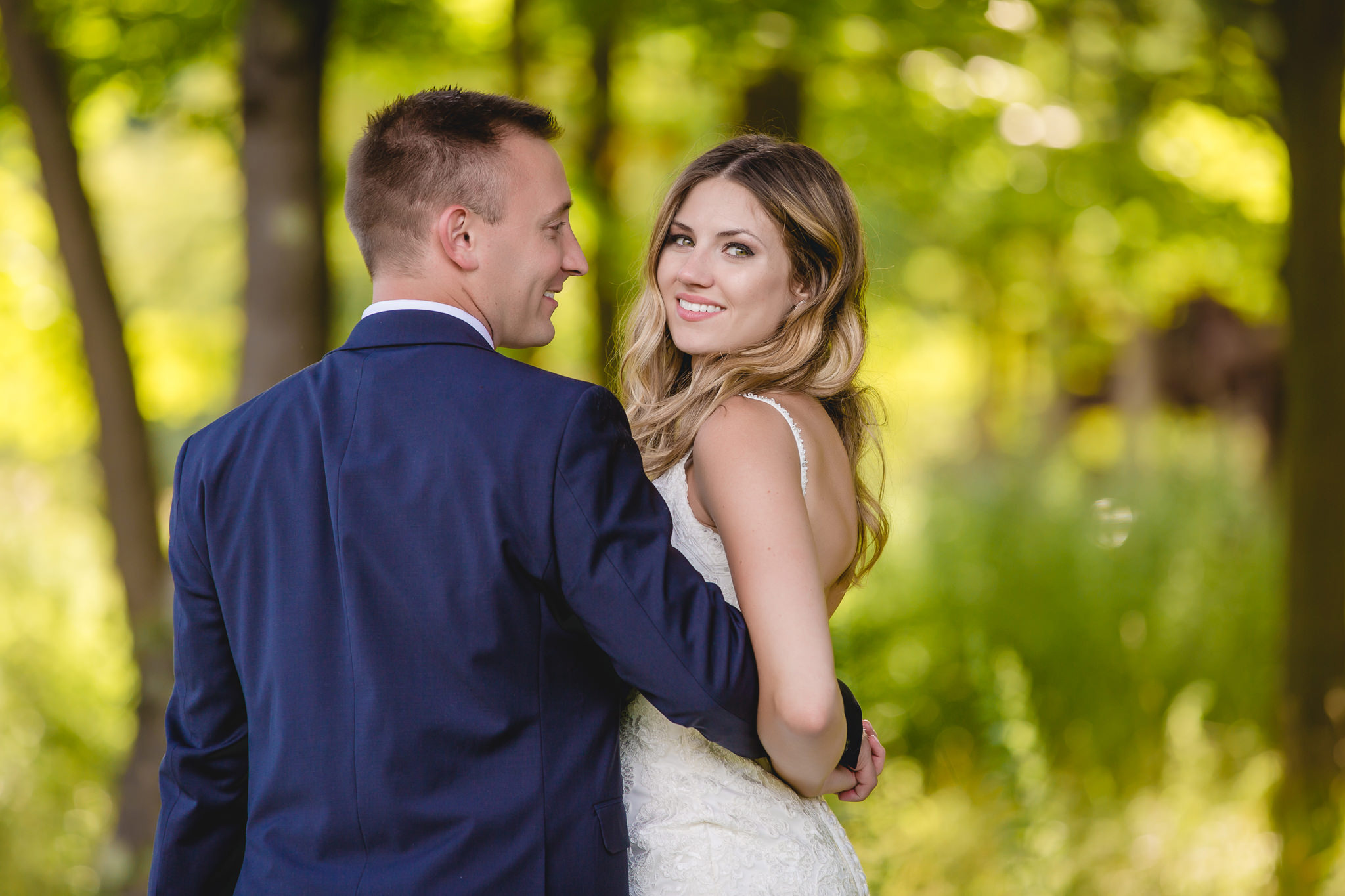 Bride smiles for a portrait with her groom at Hidden Valley Resort