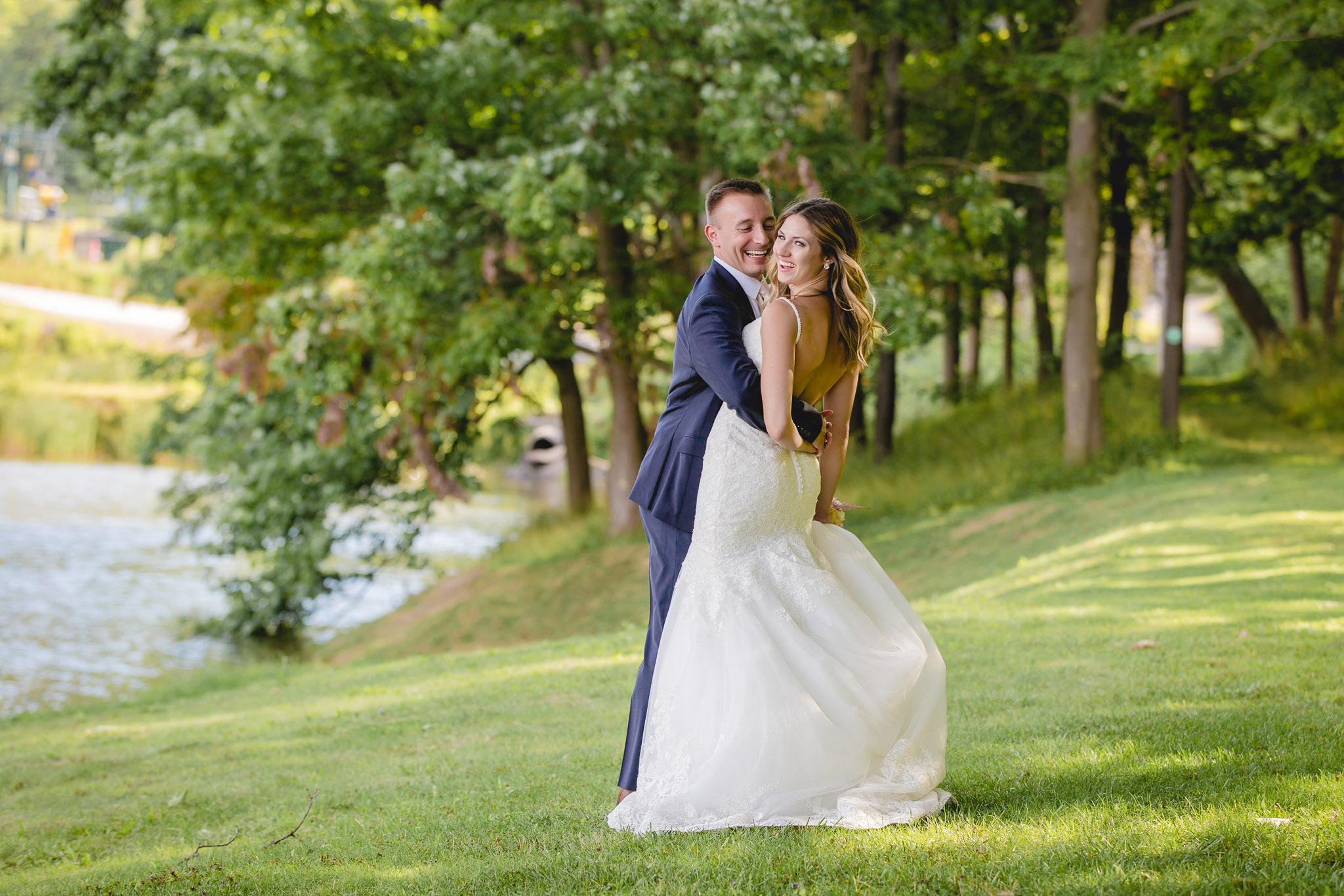 Bride and groom flirt during portraits at Hidden Valley Resort