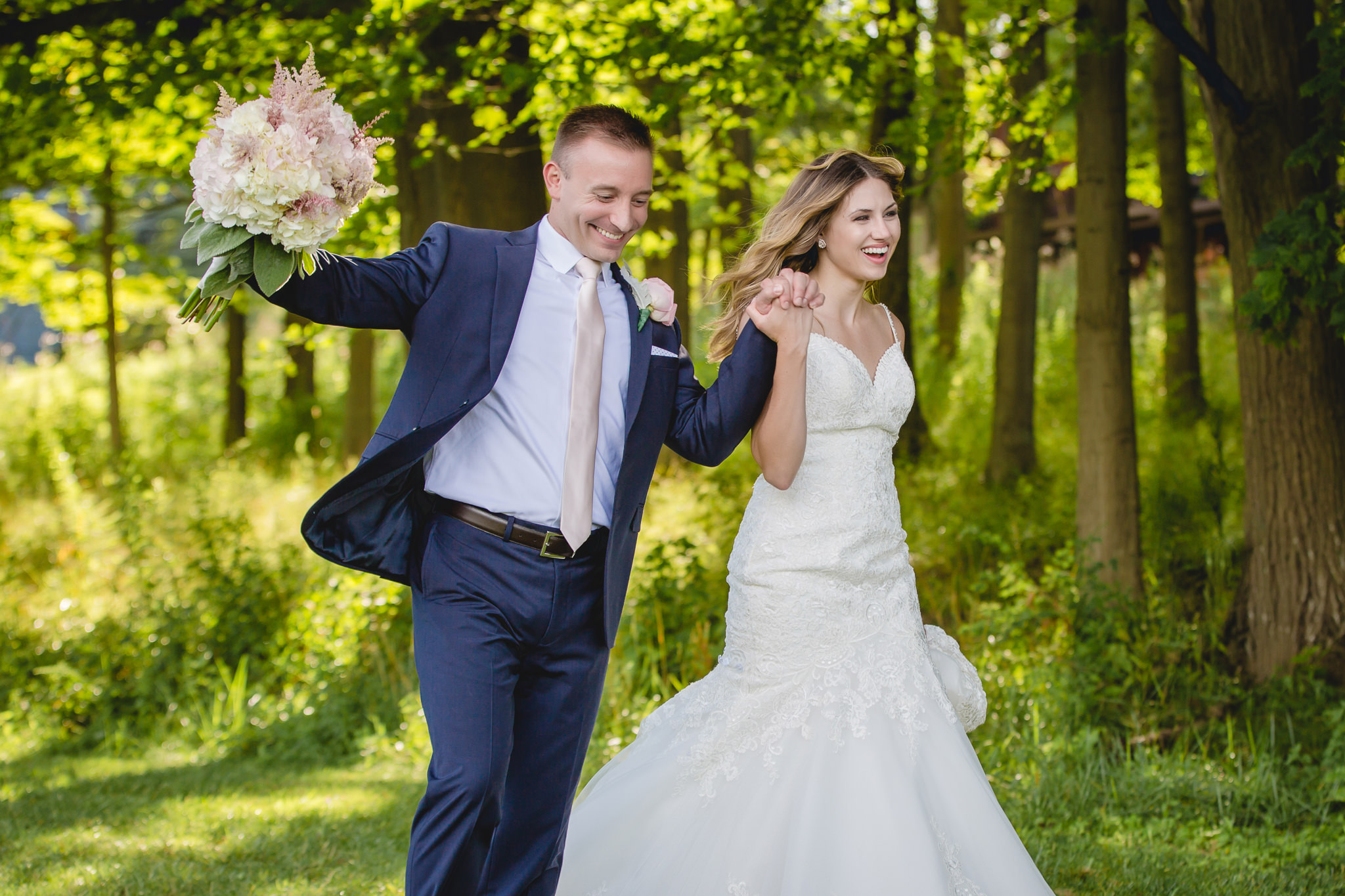 Bride and groom cheer for themselves at Hidden Valley Resort