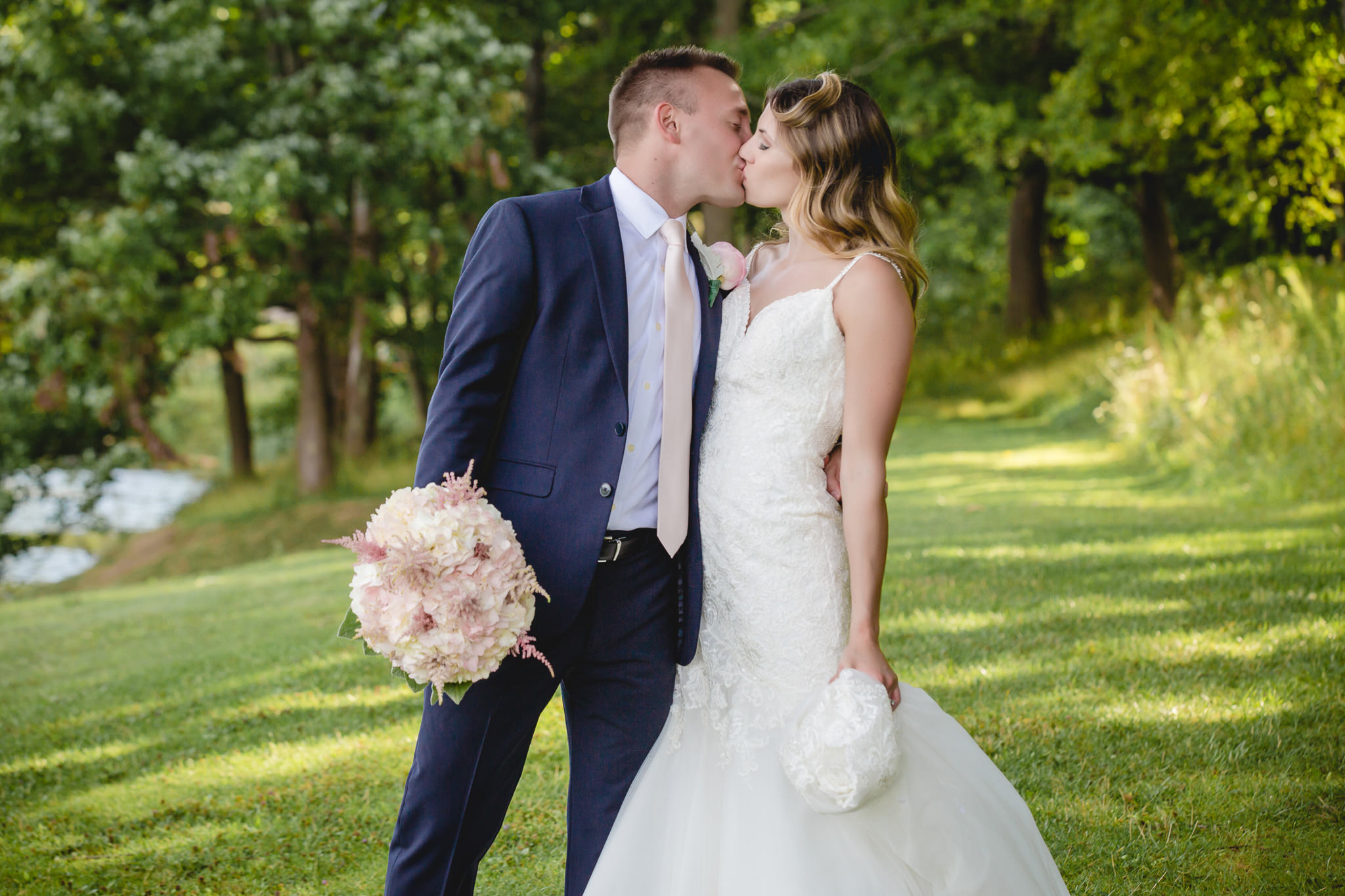 Bride and groom kiss at Hidden Valley Resort