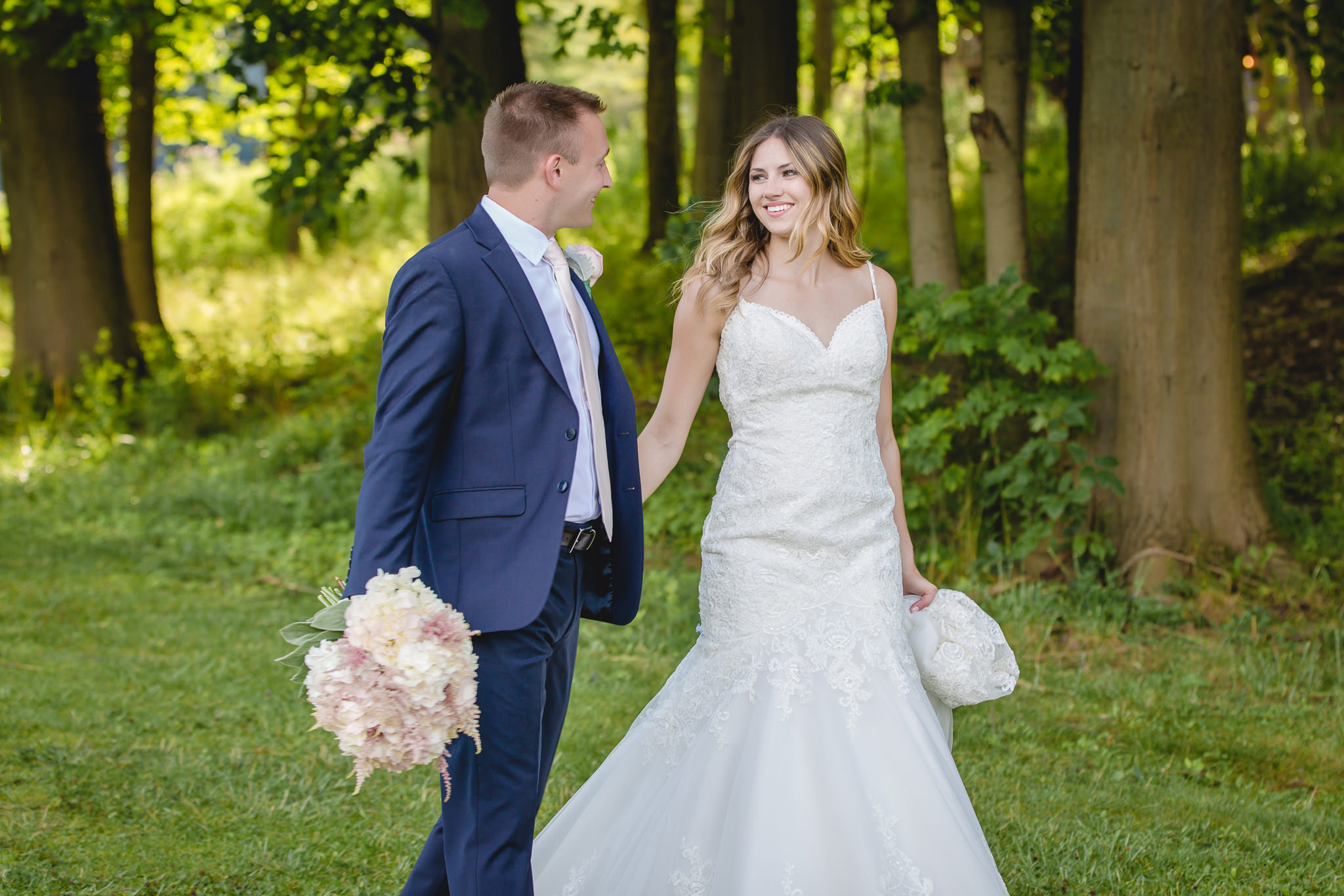 Bride and groom smile at each other during portraits at Hidden Valley Resort