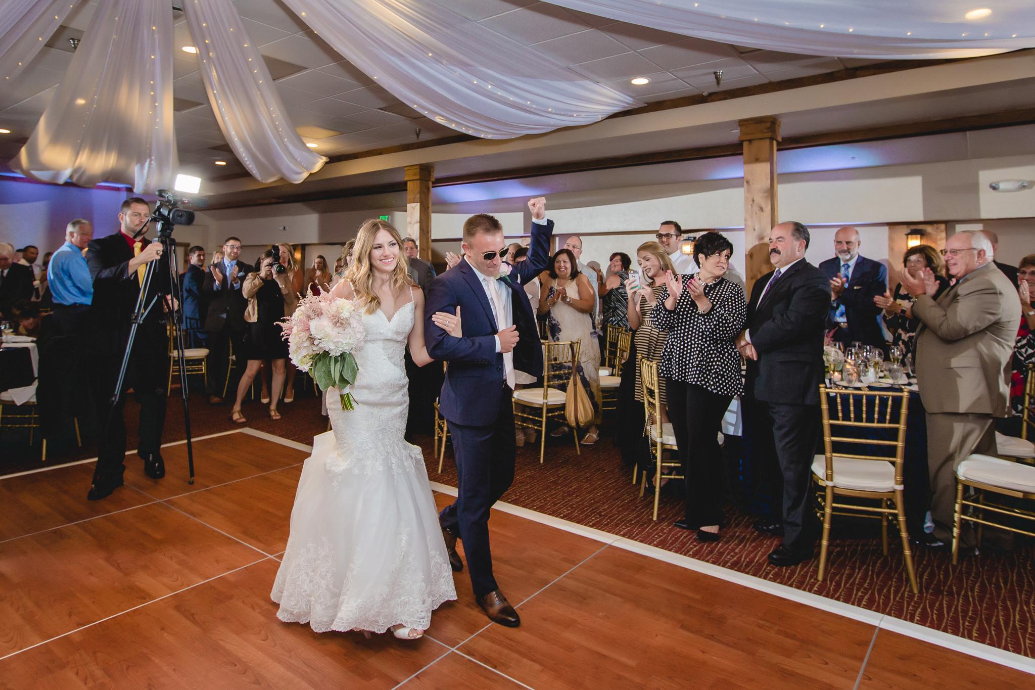 Bride and groom arrive at their Hidden Valley Resort wedding reception