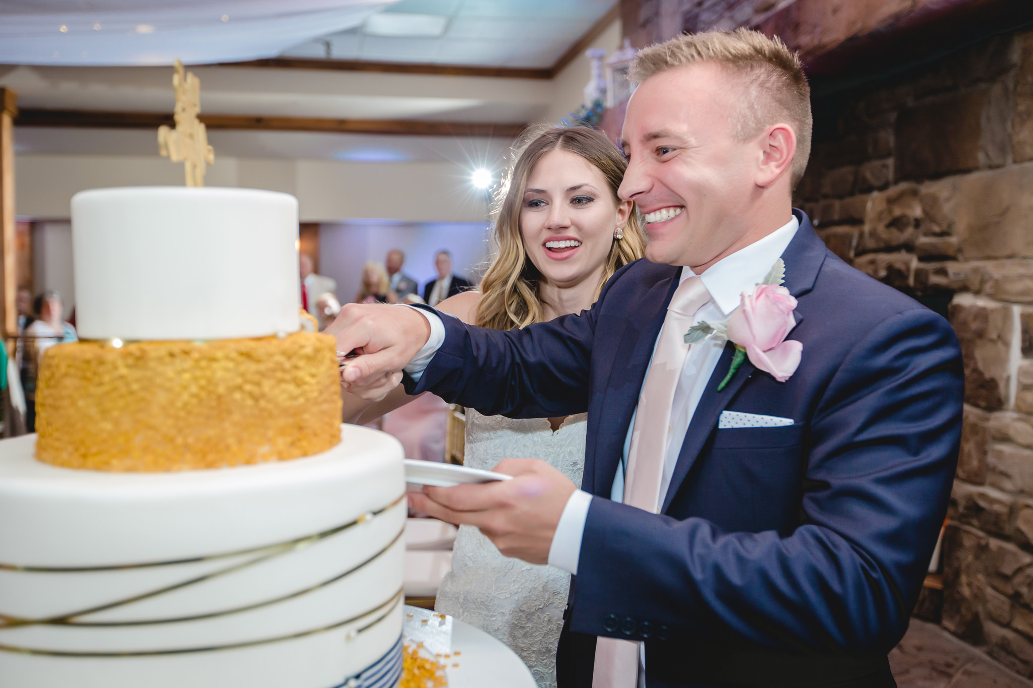 Bride and groom cut the cake at Hidden Valley Resort