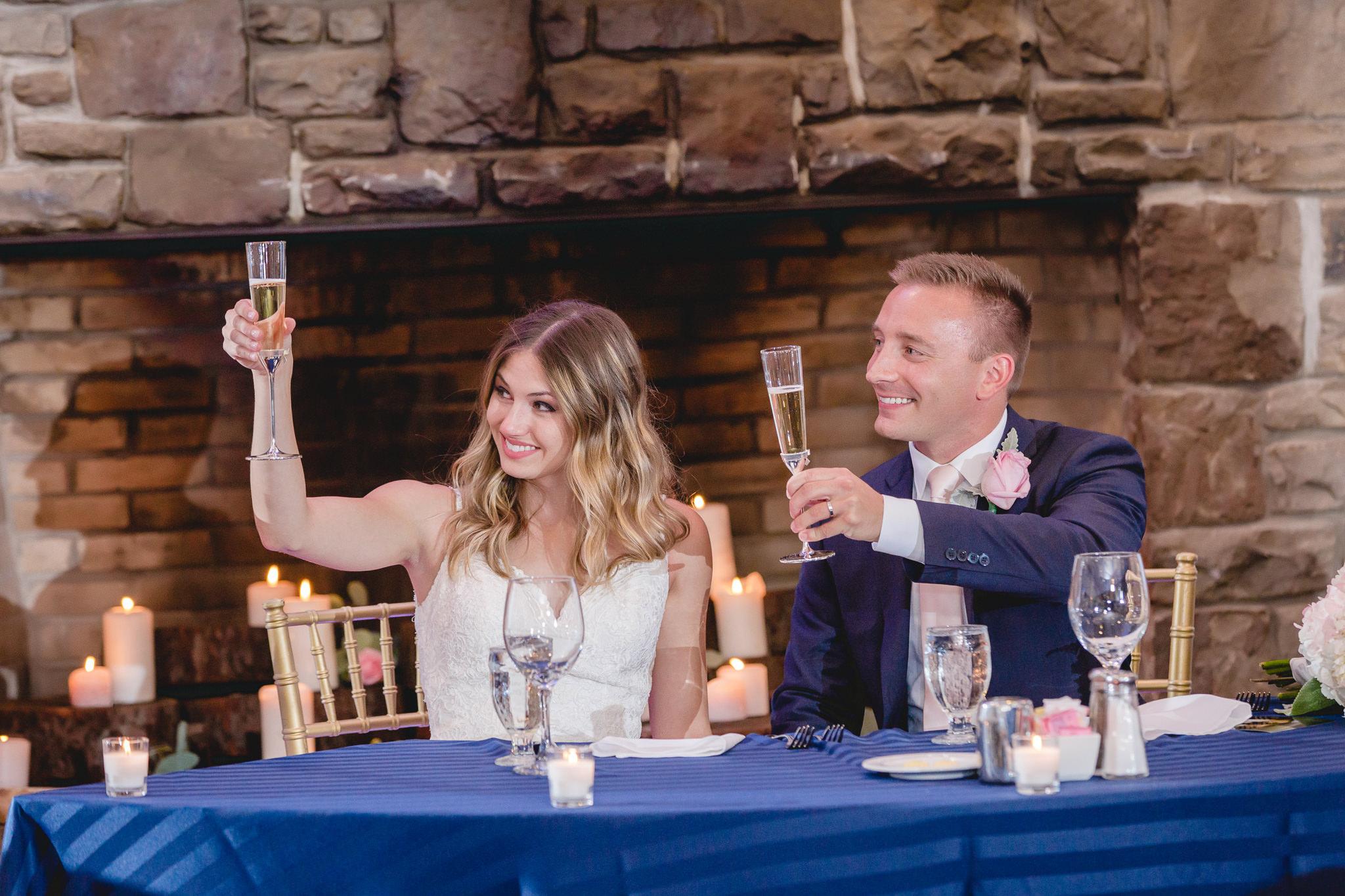 Newlyweds toast at their wedding reception at Hidden Valley Resort