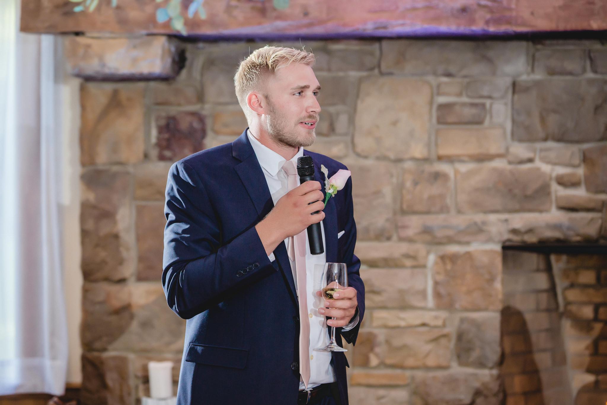 Best man gives a speech at a wedding reception at Hidden Valley Resort
