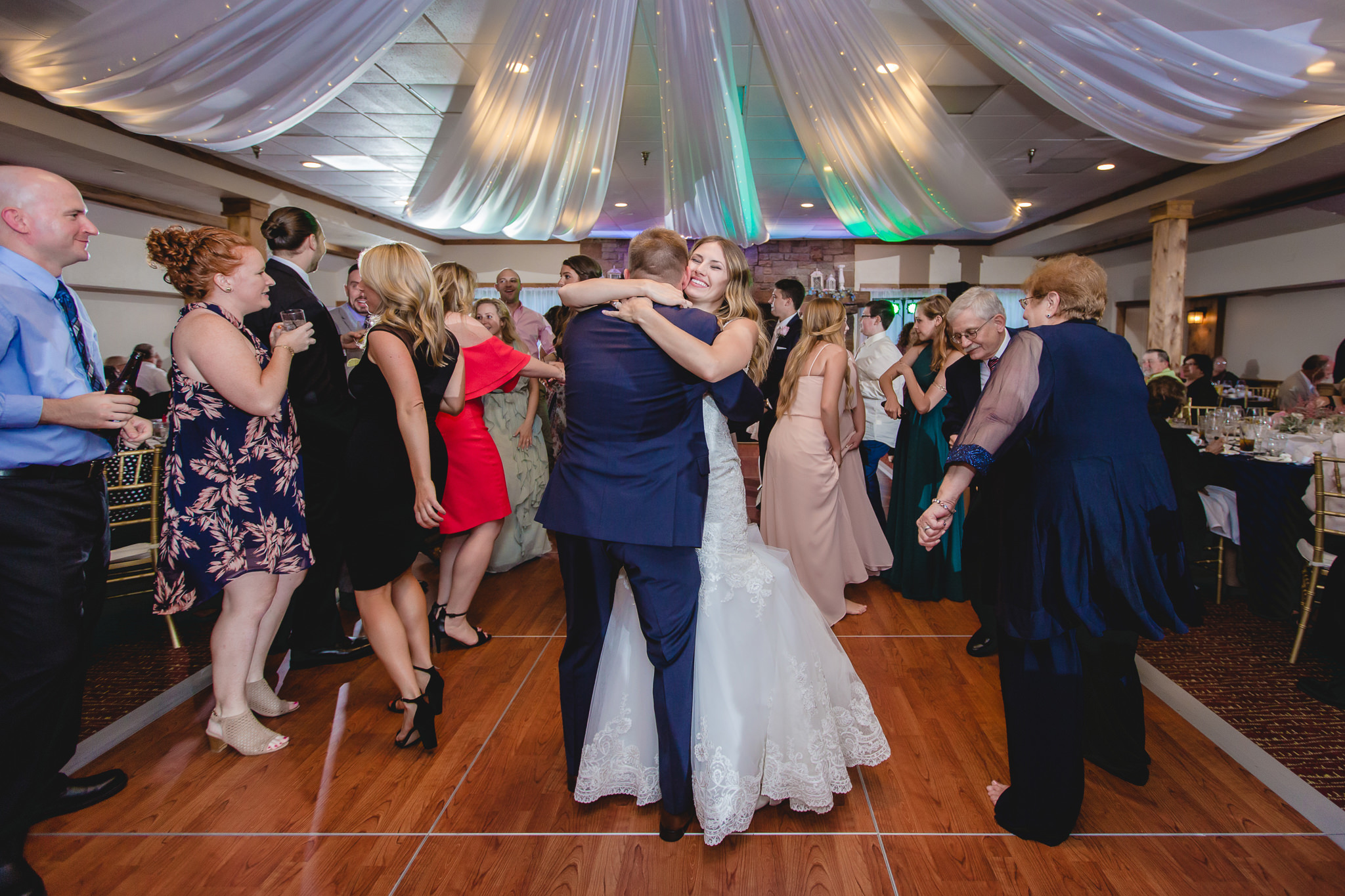 Bride and groom dance with guests at their Hidden Valley Resort wedding reception