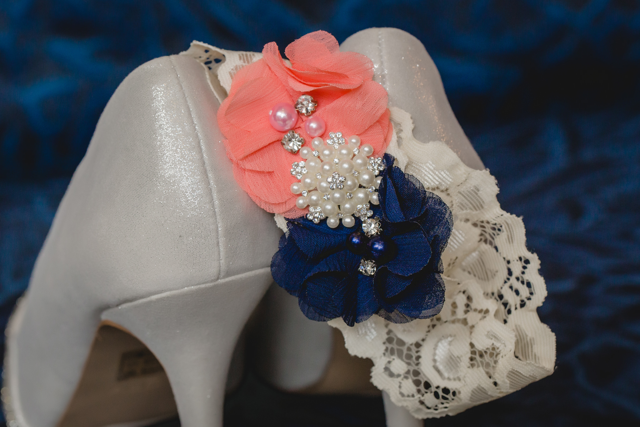Bride's garter hangs from her Aldo wedding shoes at Pittsburgh Airport Marriott