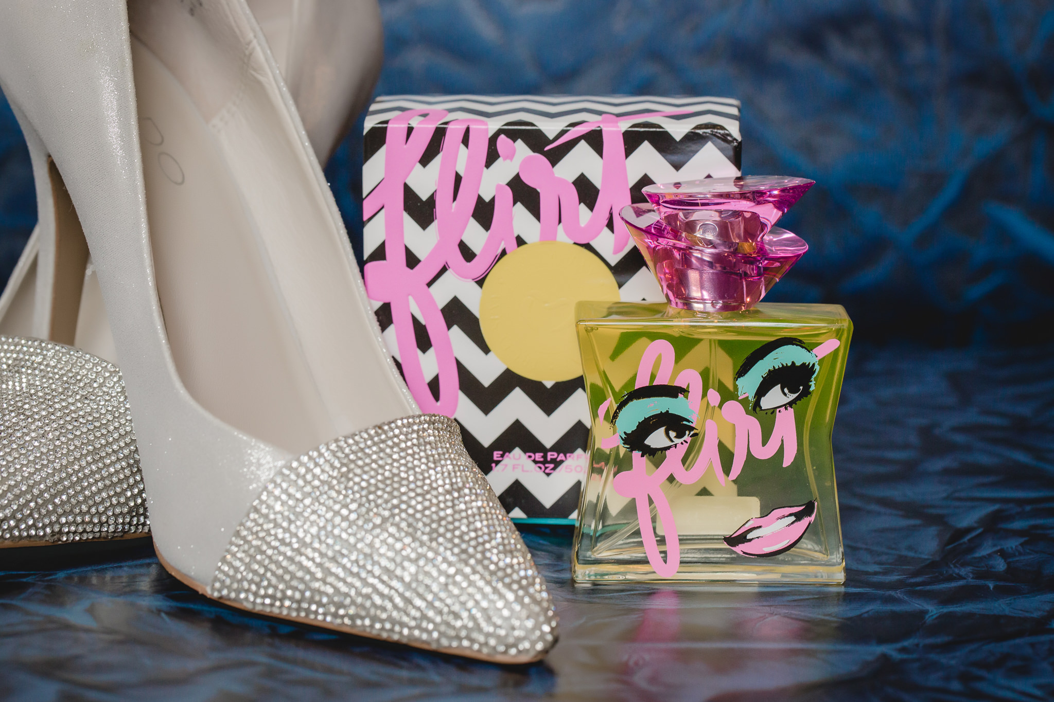 Bride's Aldo wedding shoes styled with her Flirt perfume bottle