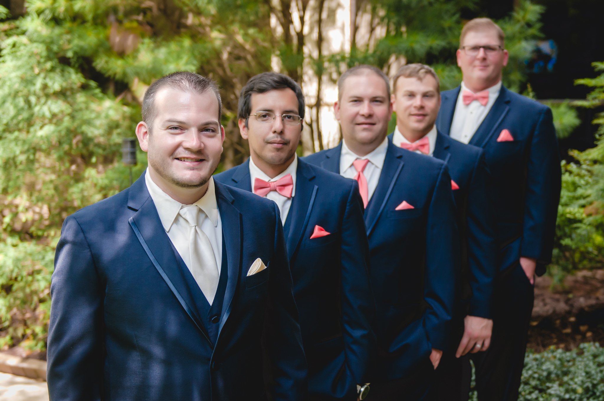 Groom with his groomsmen at the Pittsburgh Airport Marriott courtyard