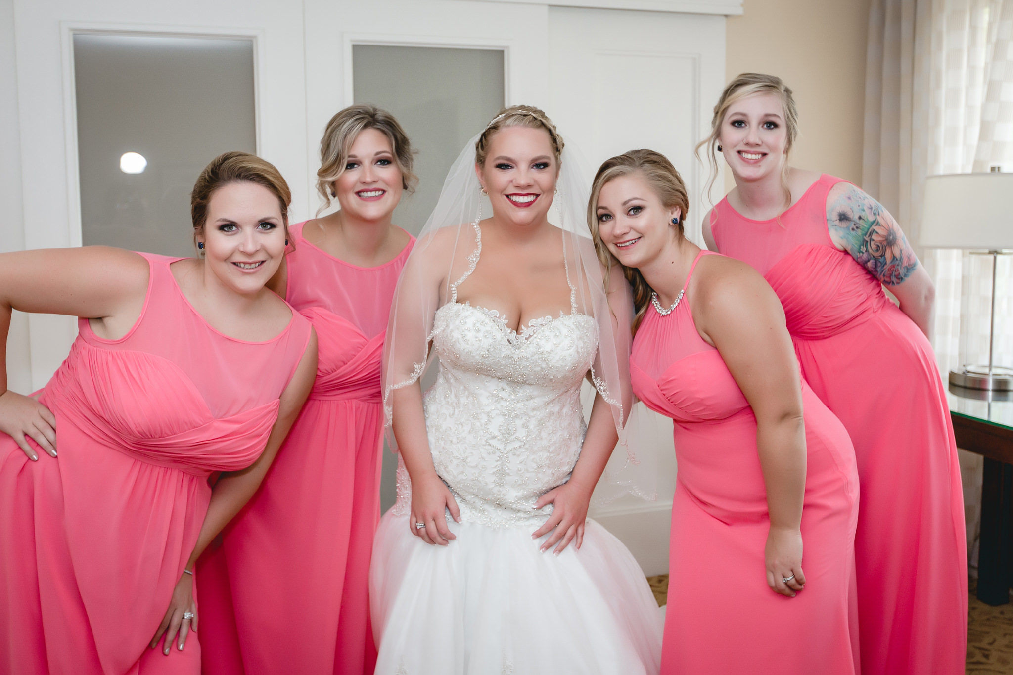 Bride poses with her bridesmaids at the Pittsburgh Airport Marriott