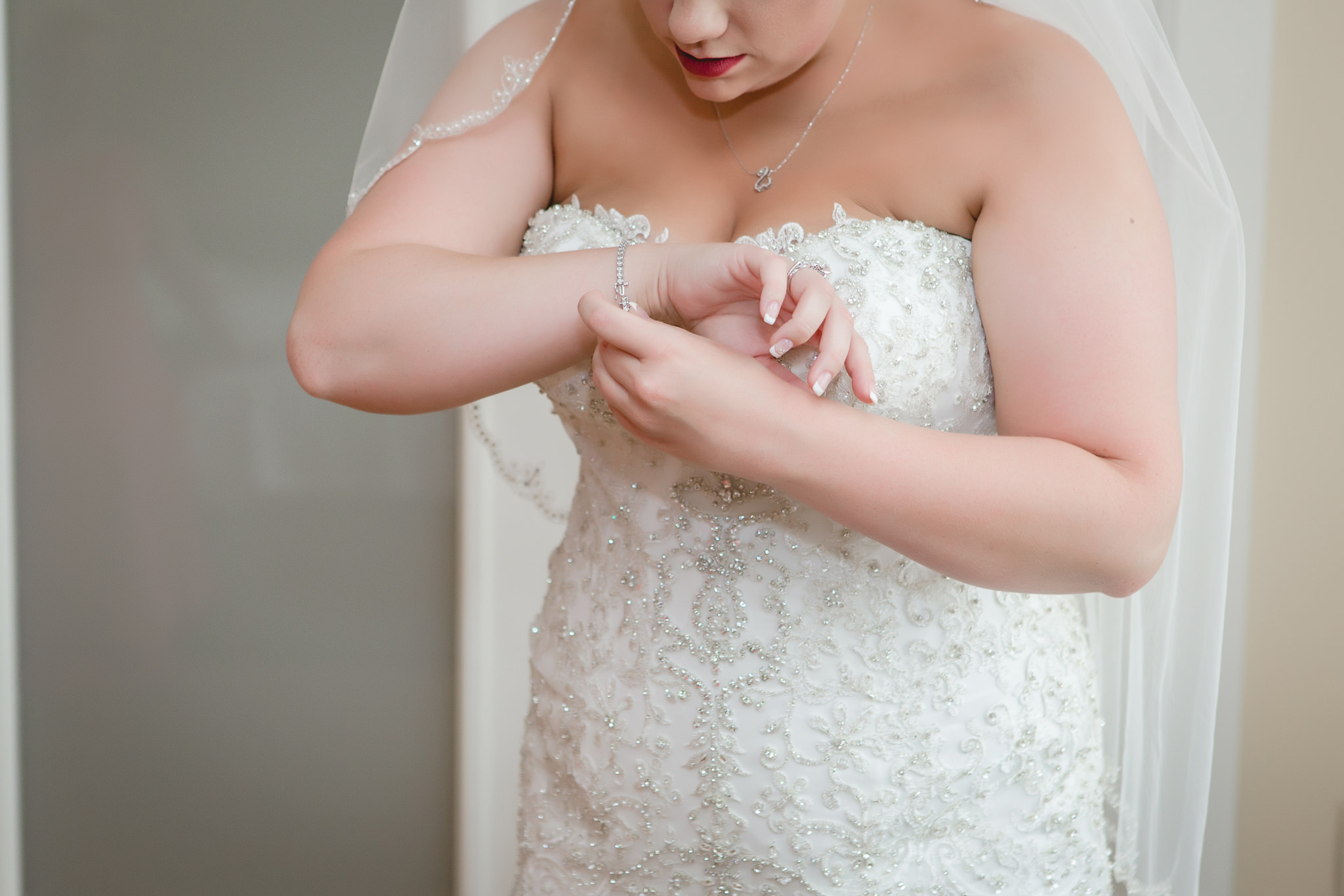Bride puts on her bracelet before her Pittsburgh Airport Marriott wedding
