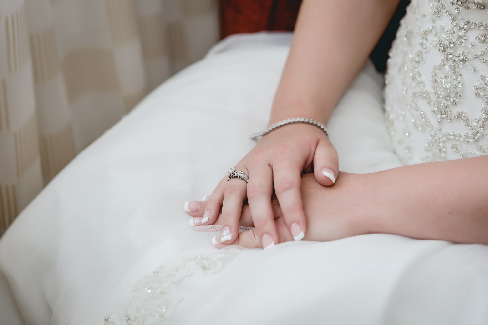 Bride's hands in her lap as she patiently waits for her wedding ceremony to begin