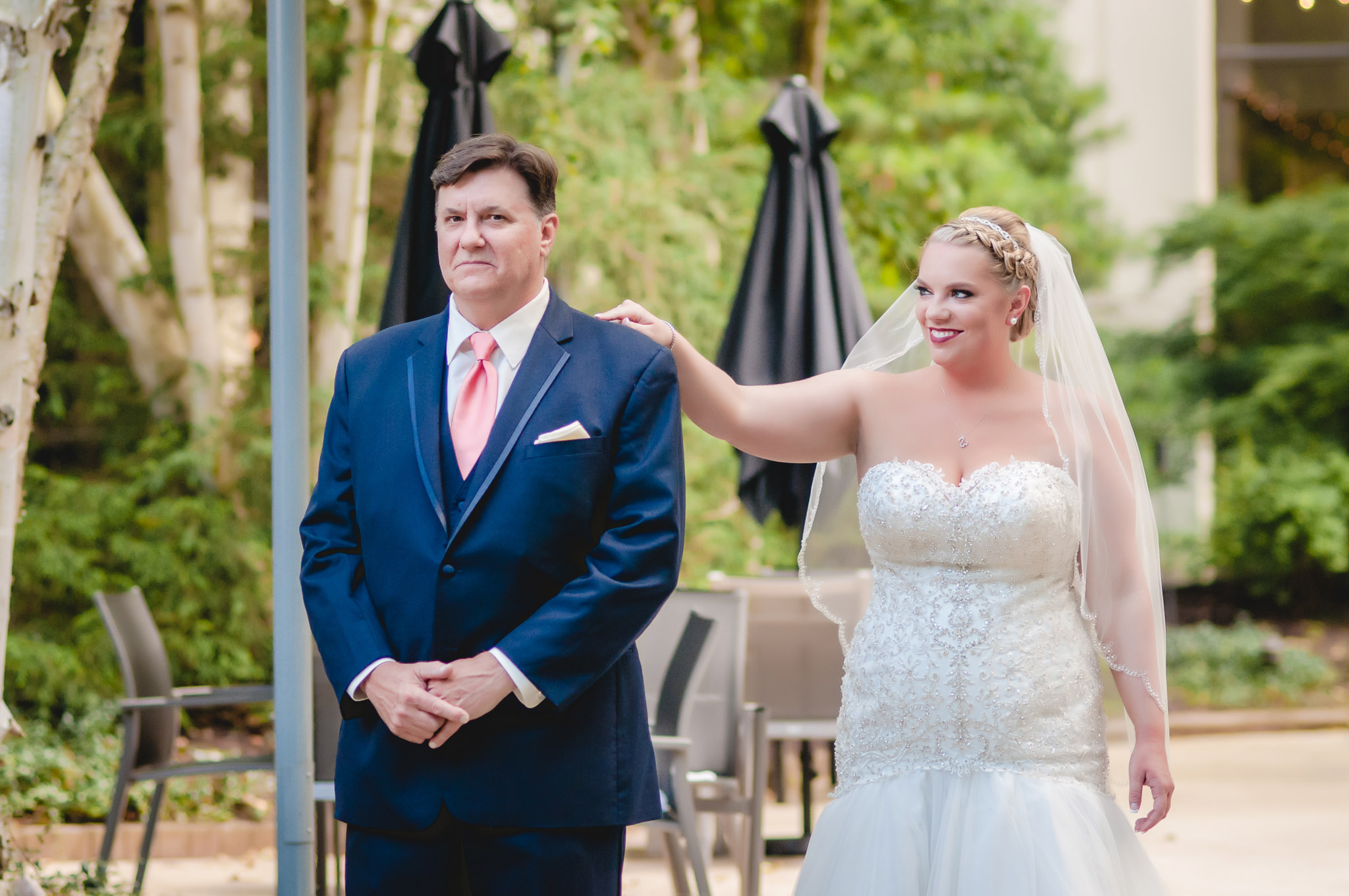 Bride taps her dad on the shoulder during a first look