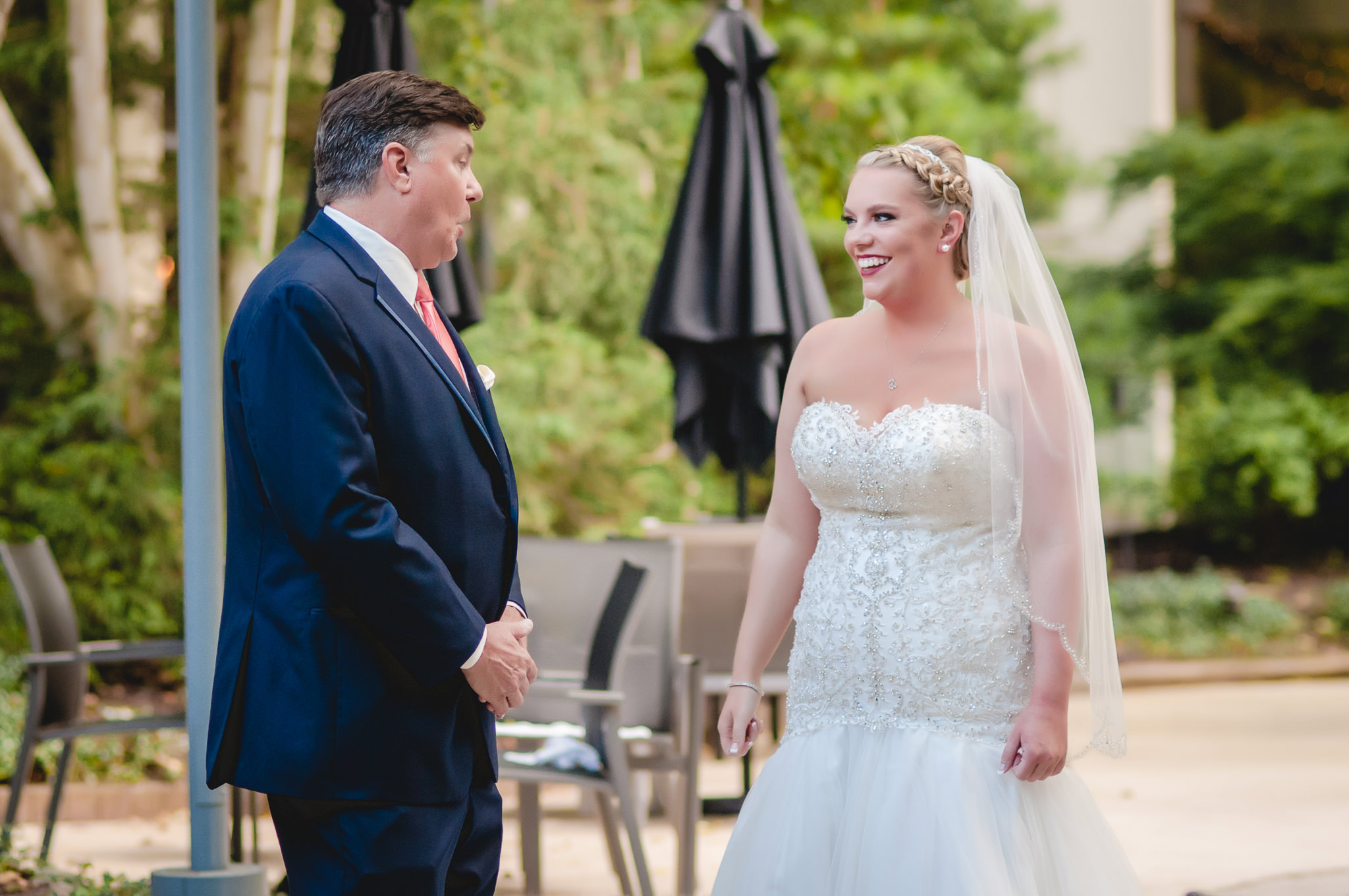 Father of the bride sees his daughter in her wedding attire for the first time