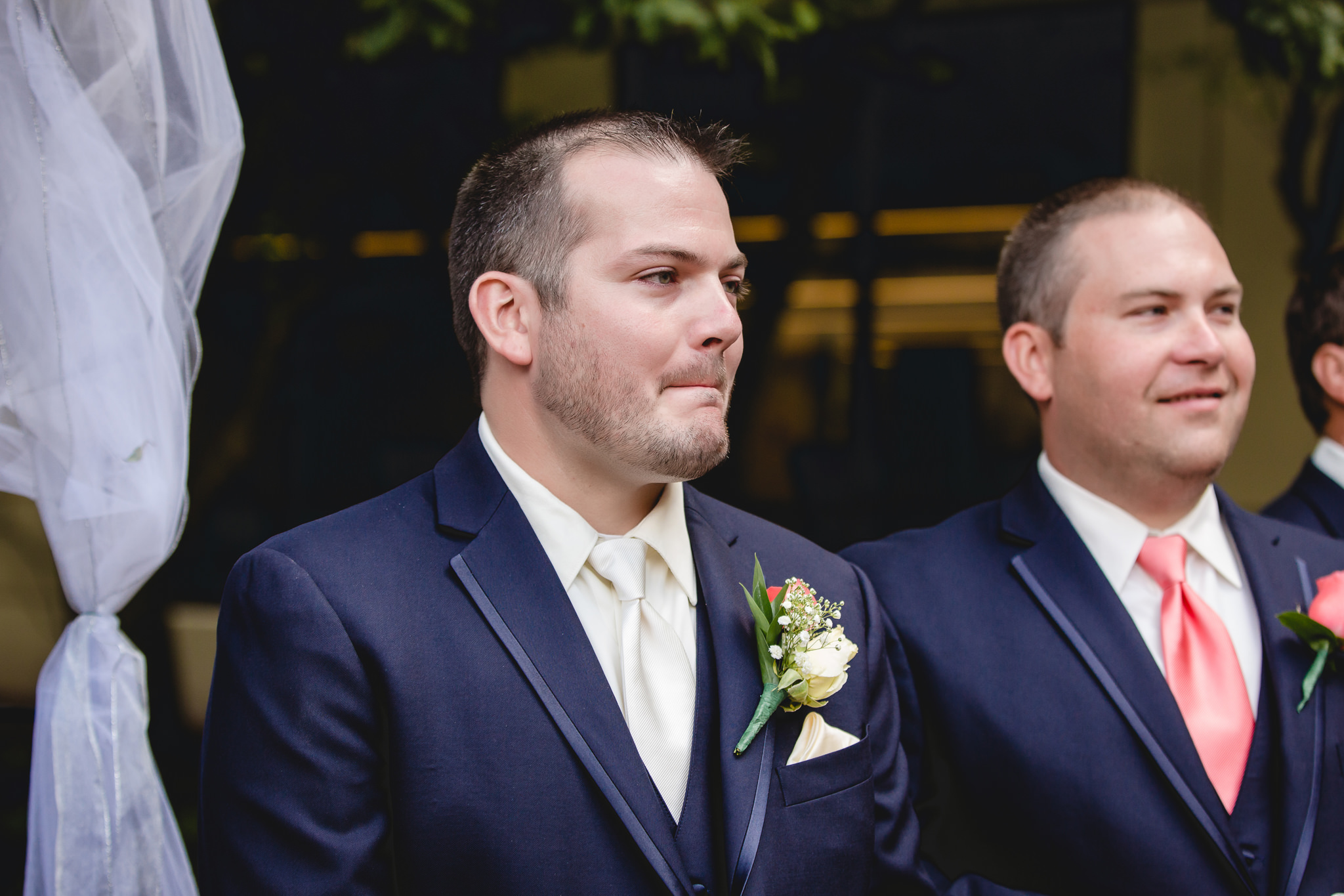 Groom holds back tears as he watches the bride walking down the aisle