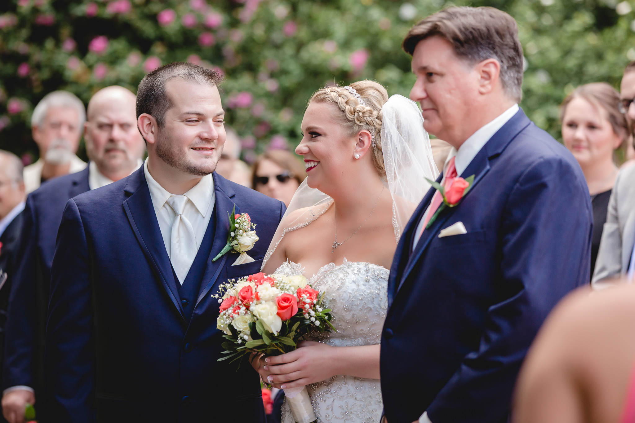 Bride and groom smile at each other at a Pittsburgh Airport Marriott wedding ceremony