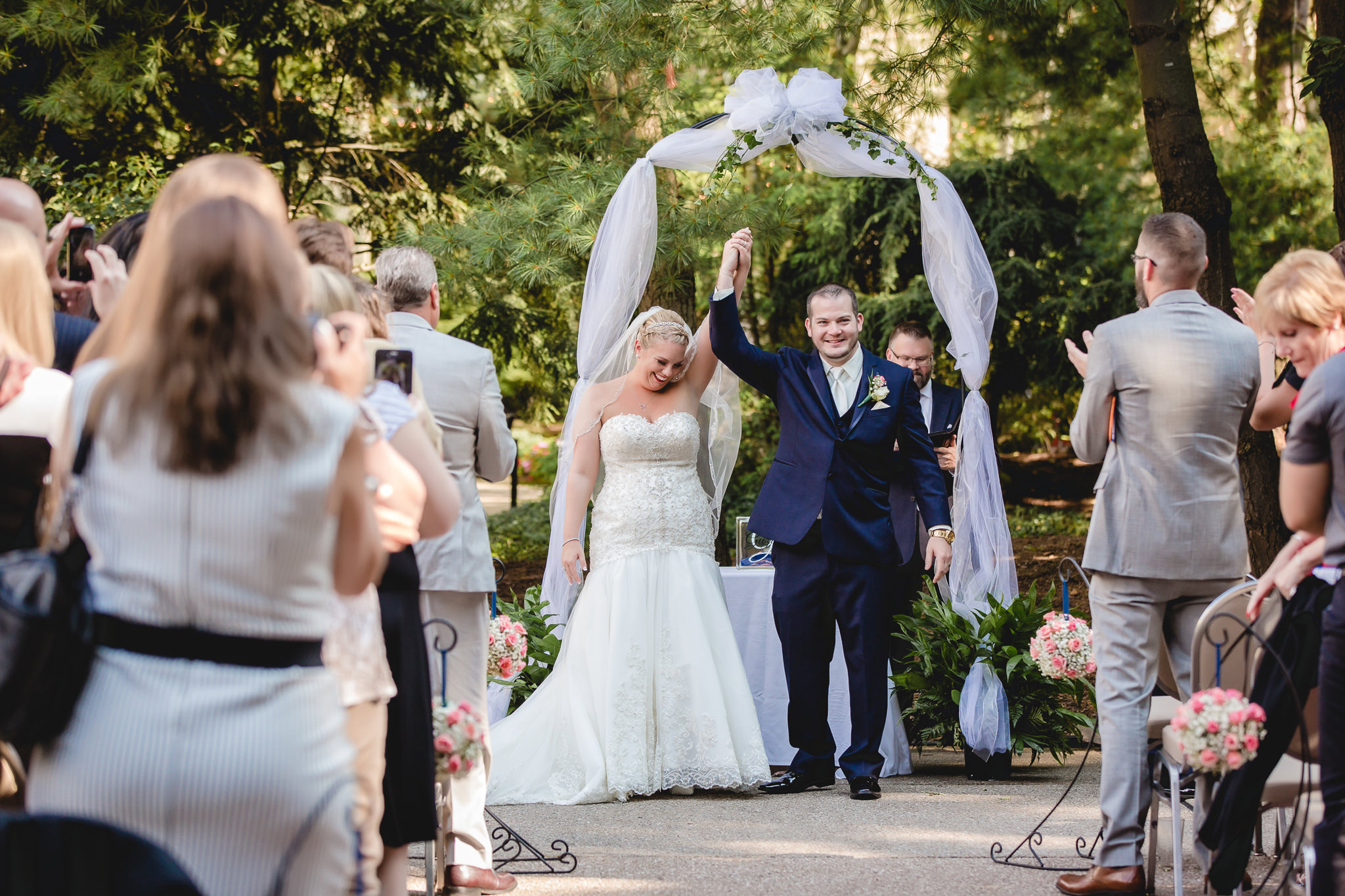 Bride and groom celebrate as they're announced as husband and wife
