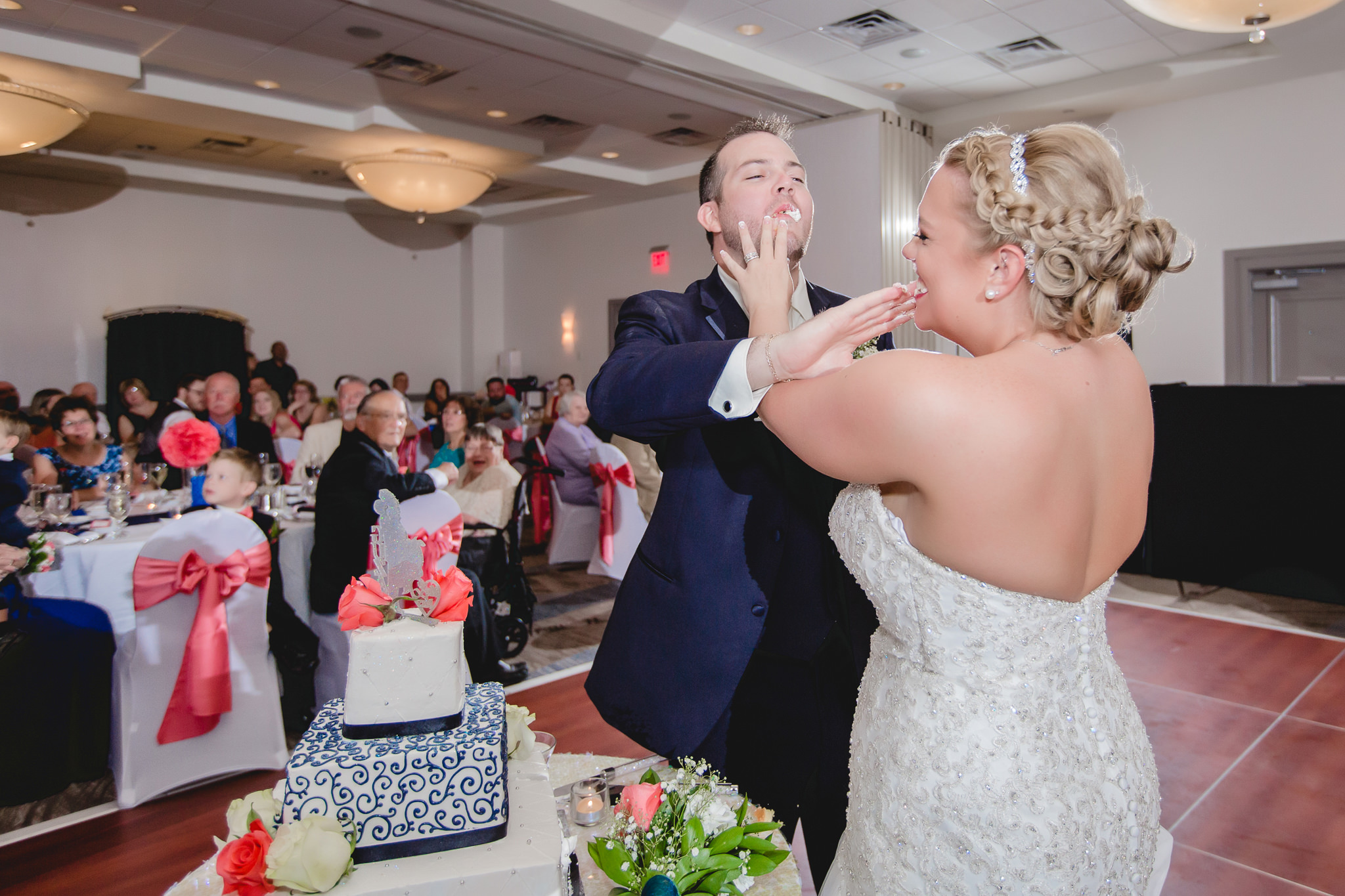 Bride and groom smash cake in each other's faces