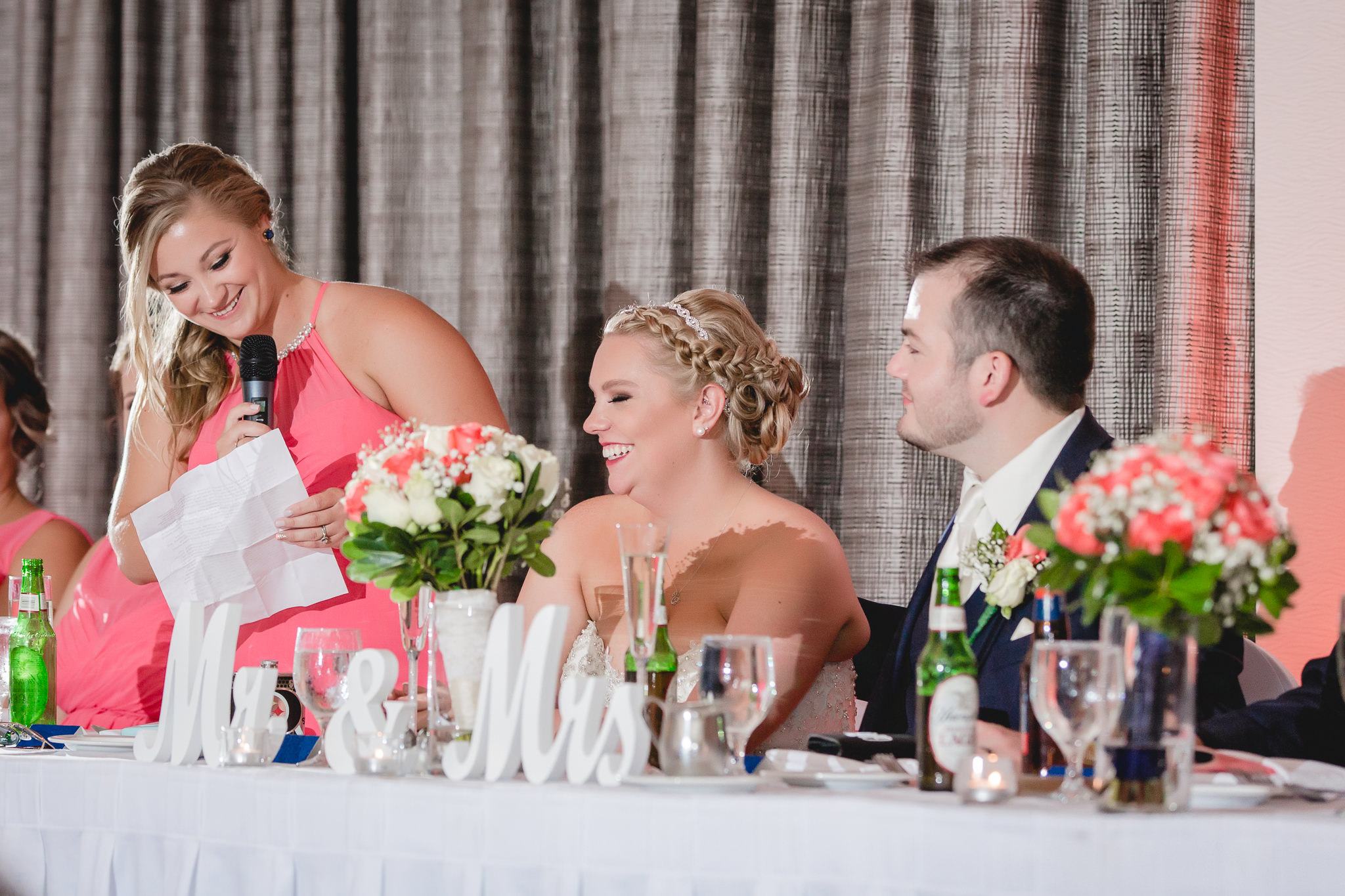 Matron of honor gives a toasts at a Pittsburgh Airport Marriott wedding reception