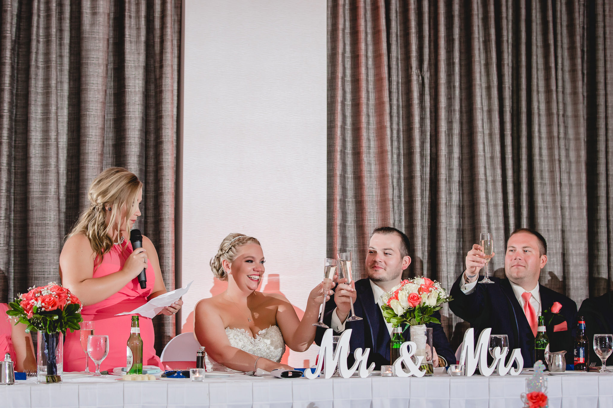 Bride and groom toast at their Pittsburgh Airport Marriott wedding reception