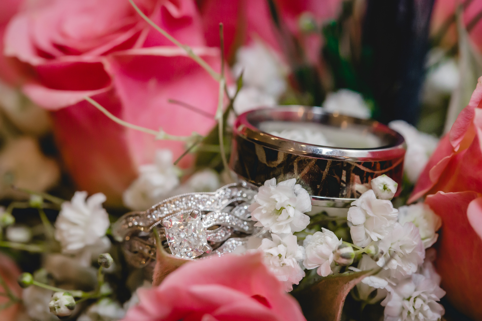 Bride's diamond wedding bands with the groom's camo wedding band