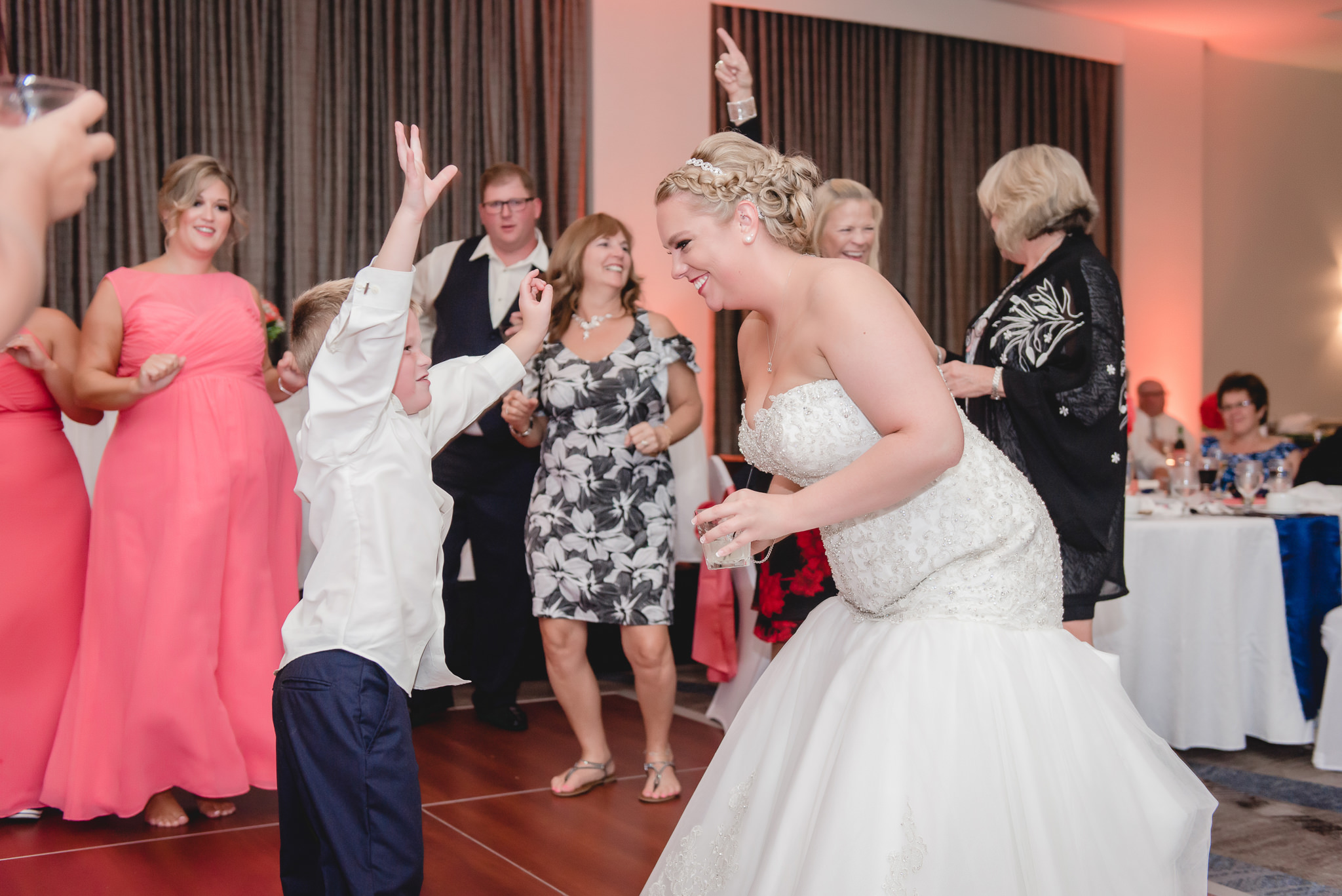 Bride dances with the ring bearer at a Pittsburgh Airport Marriott reception