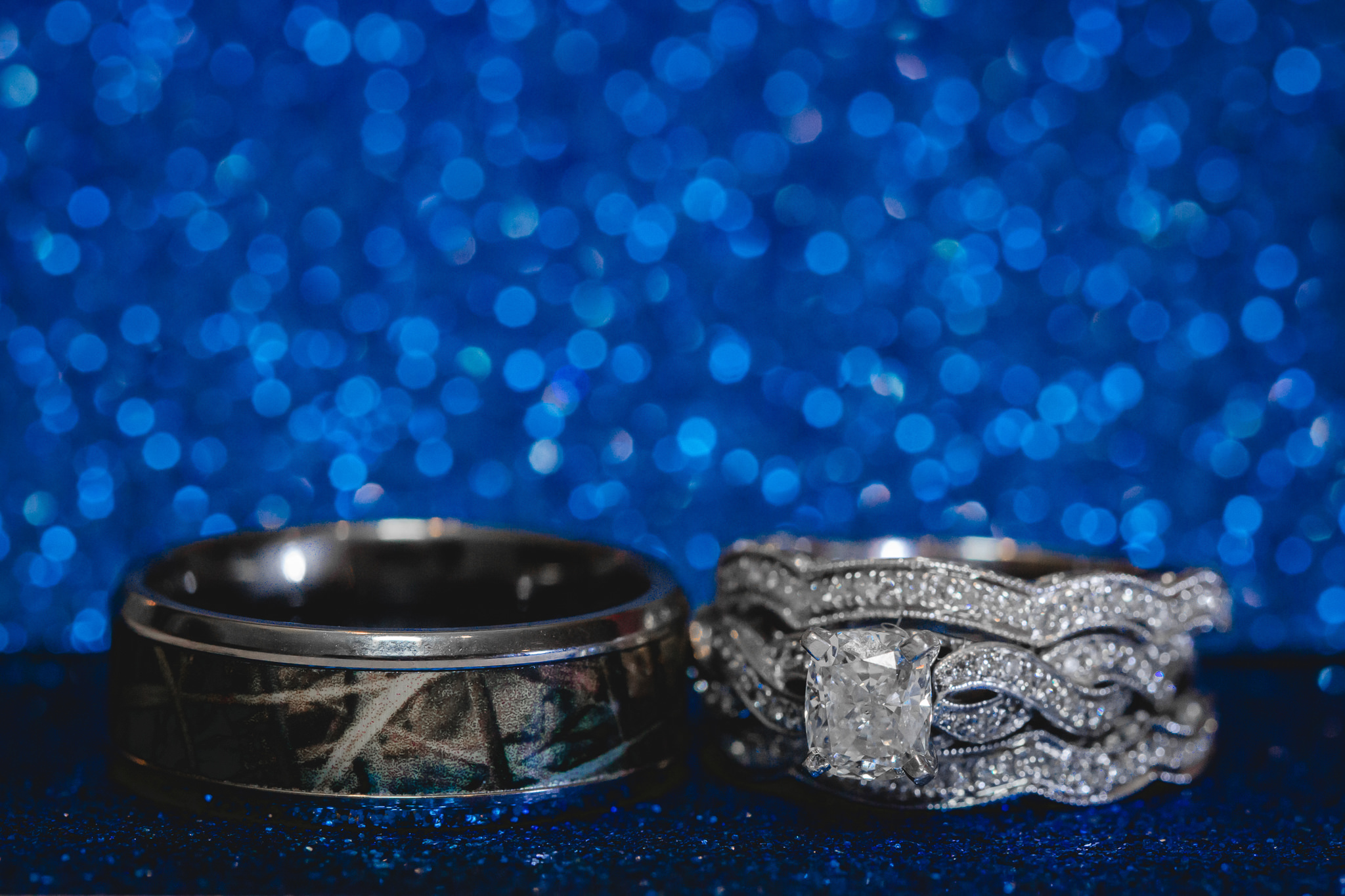 Wedding bands on blue glitter paper