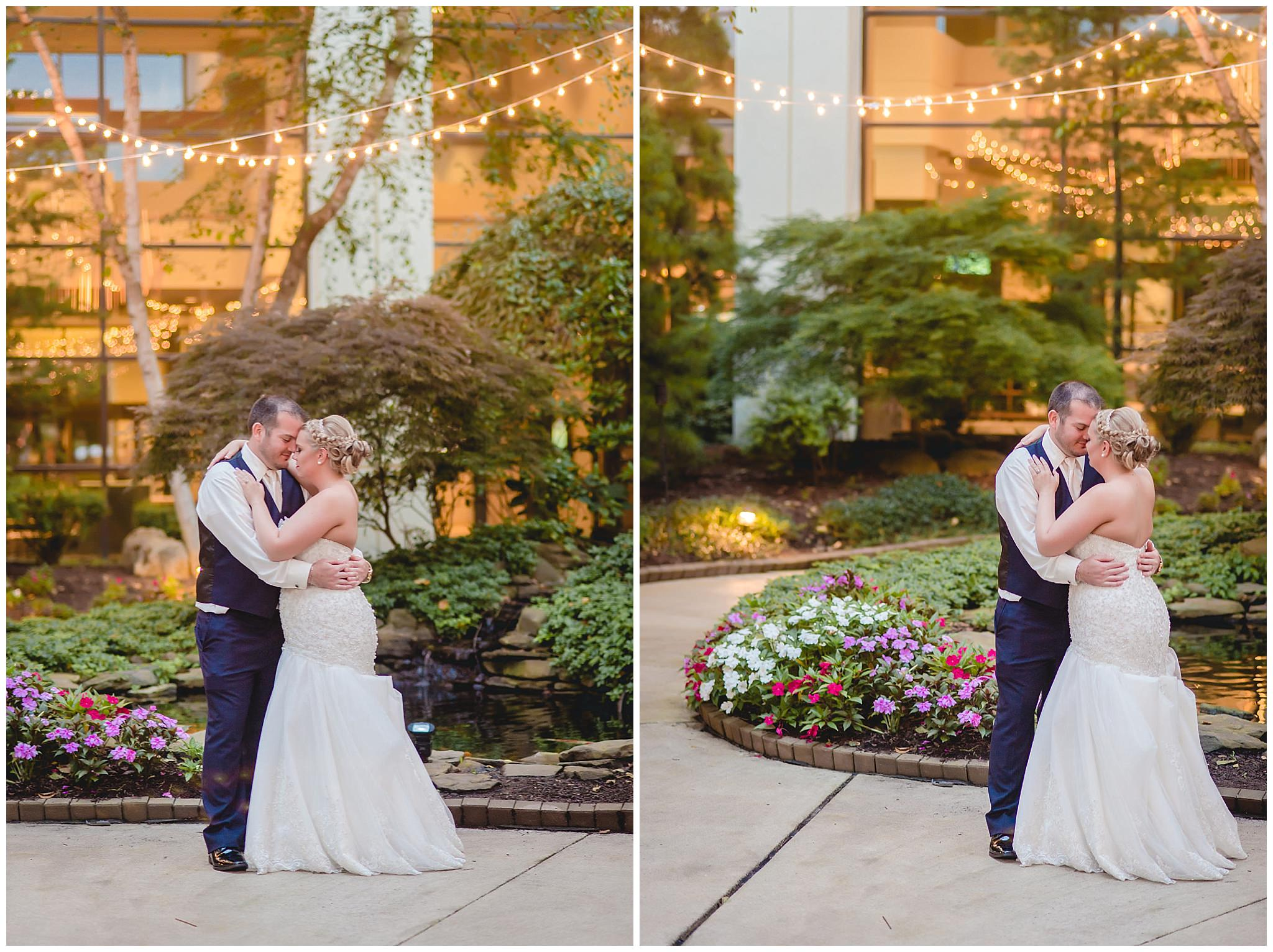 Bride & groom share a quiet moment at dusk in the courtyard of the Pittsburgh Airport Marriott