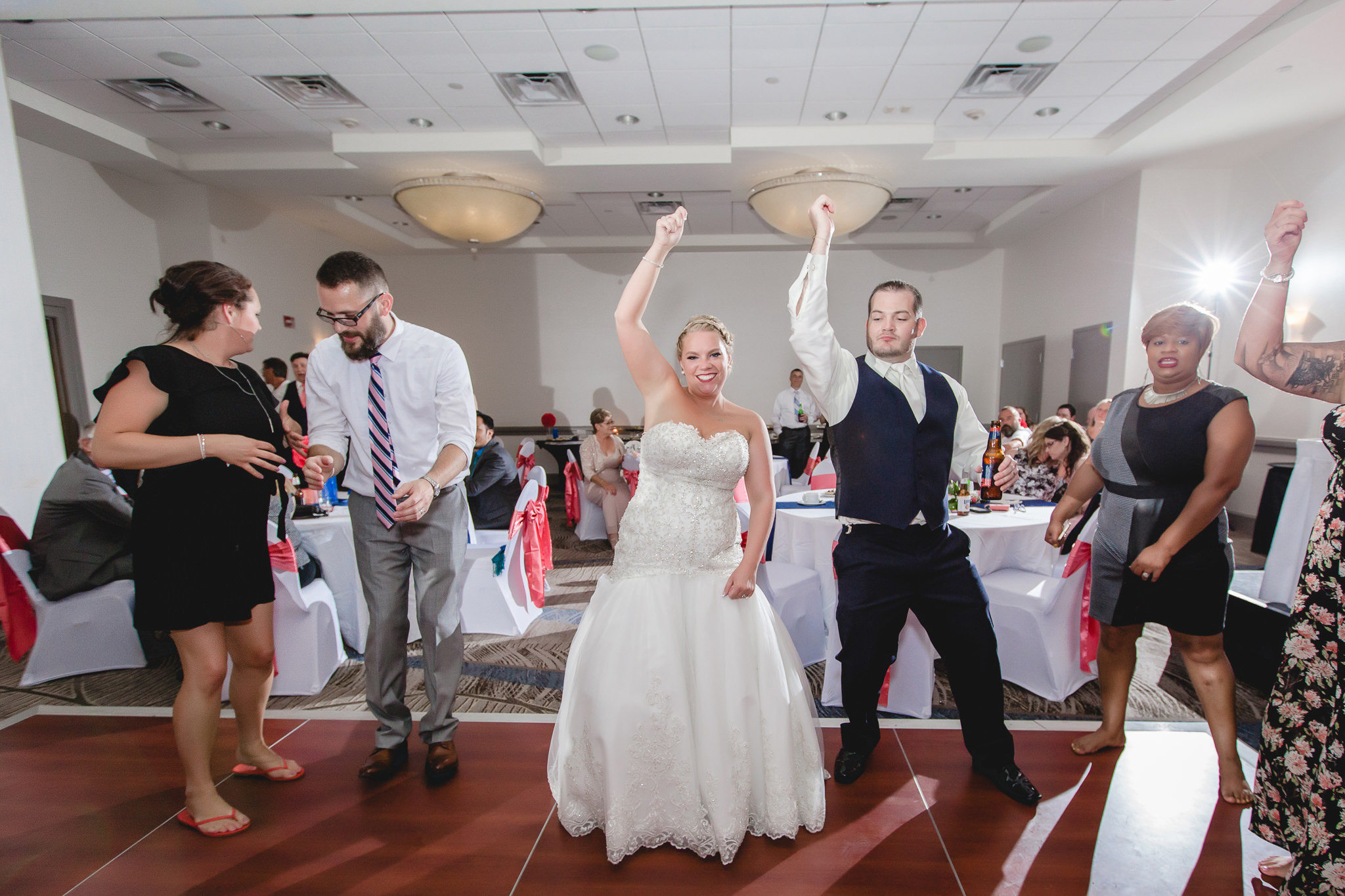 Bride and groom dance with guests at the Pittsburgh Airport Marriott