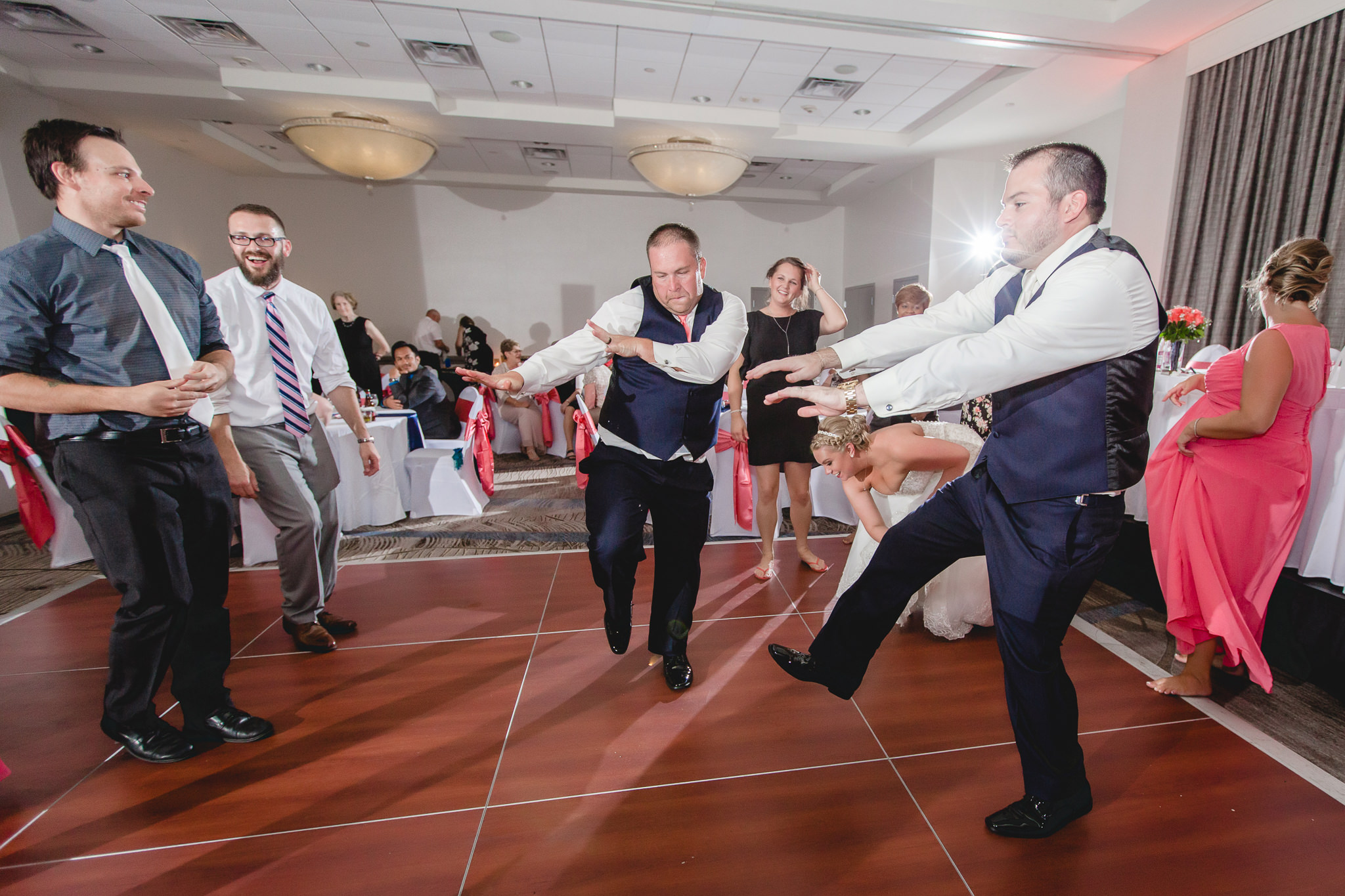 Groom dances with his brother at the Pittsburgh Airport Marriott