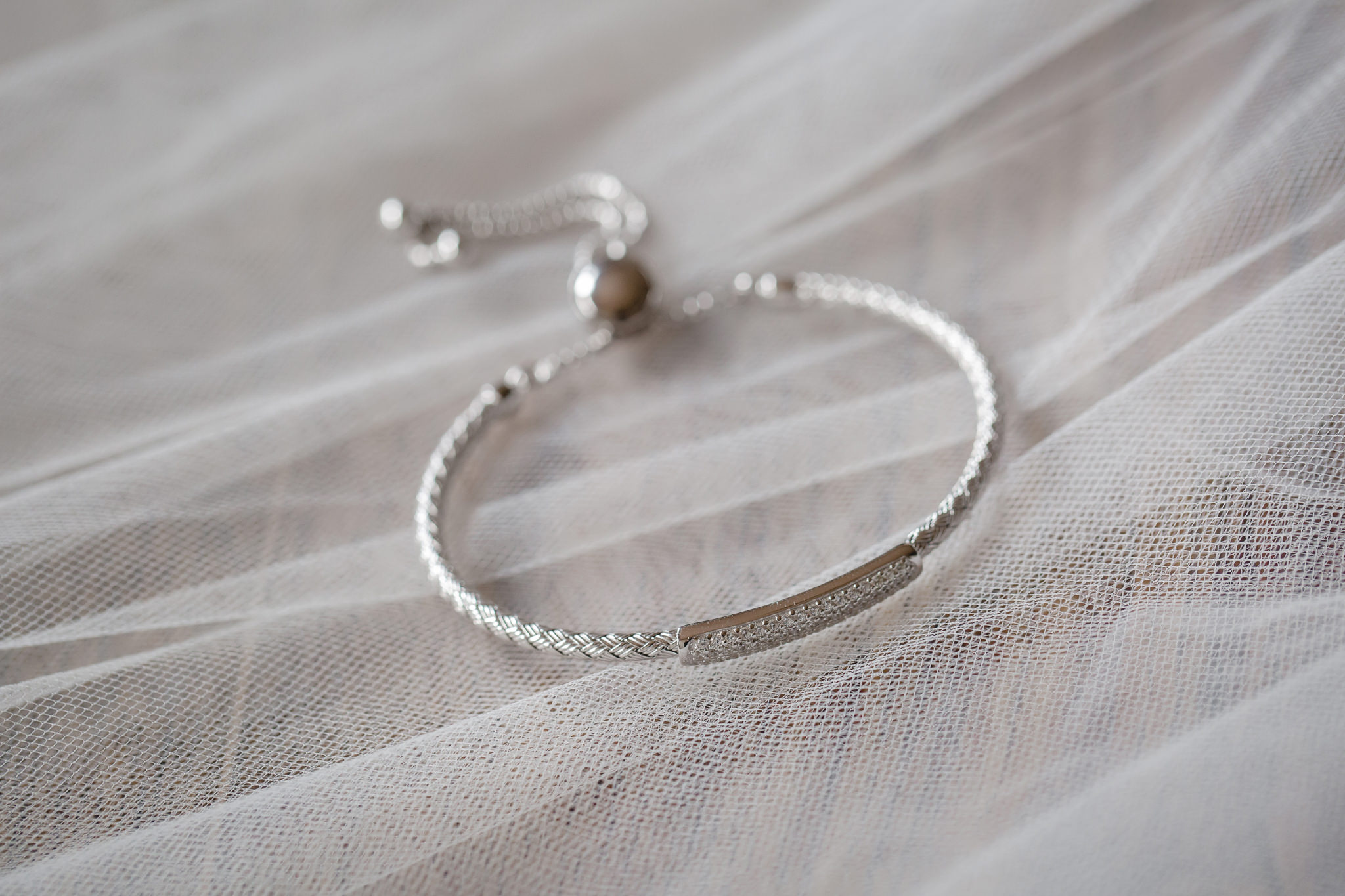 Closeup of a bride's bracelet she'll wear on her wedding day