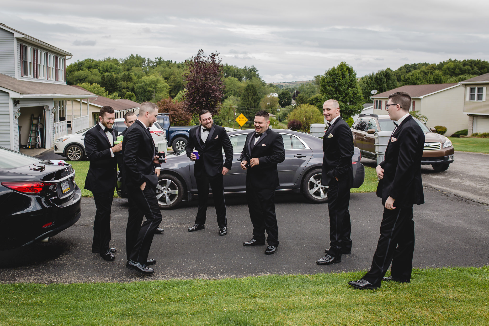 Groom laughs with his groomsmen before his ceremony at the Gathering Place at Darlington Lake
