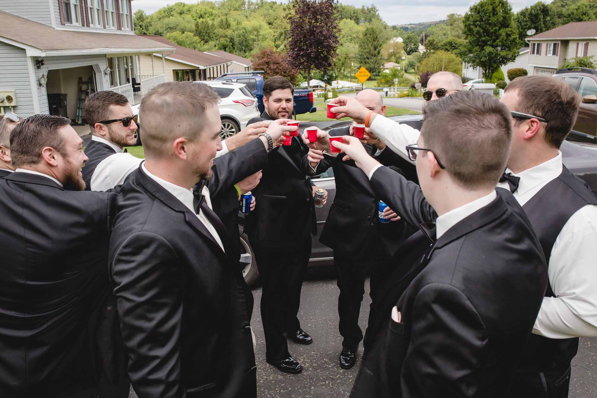 Groomsmen toast the groom before his wedding at the Gathering Place at Darlington Lake