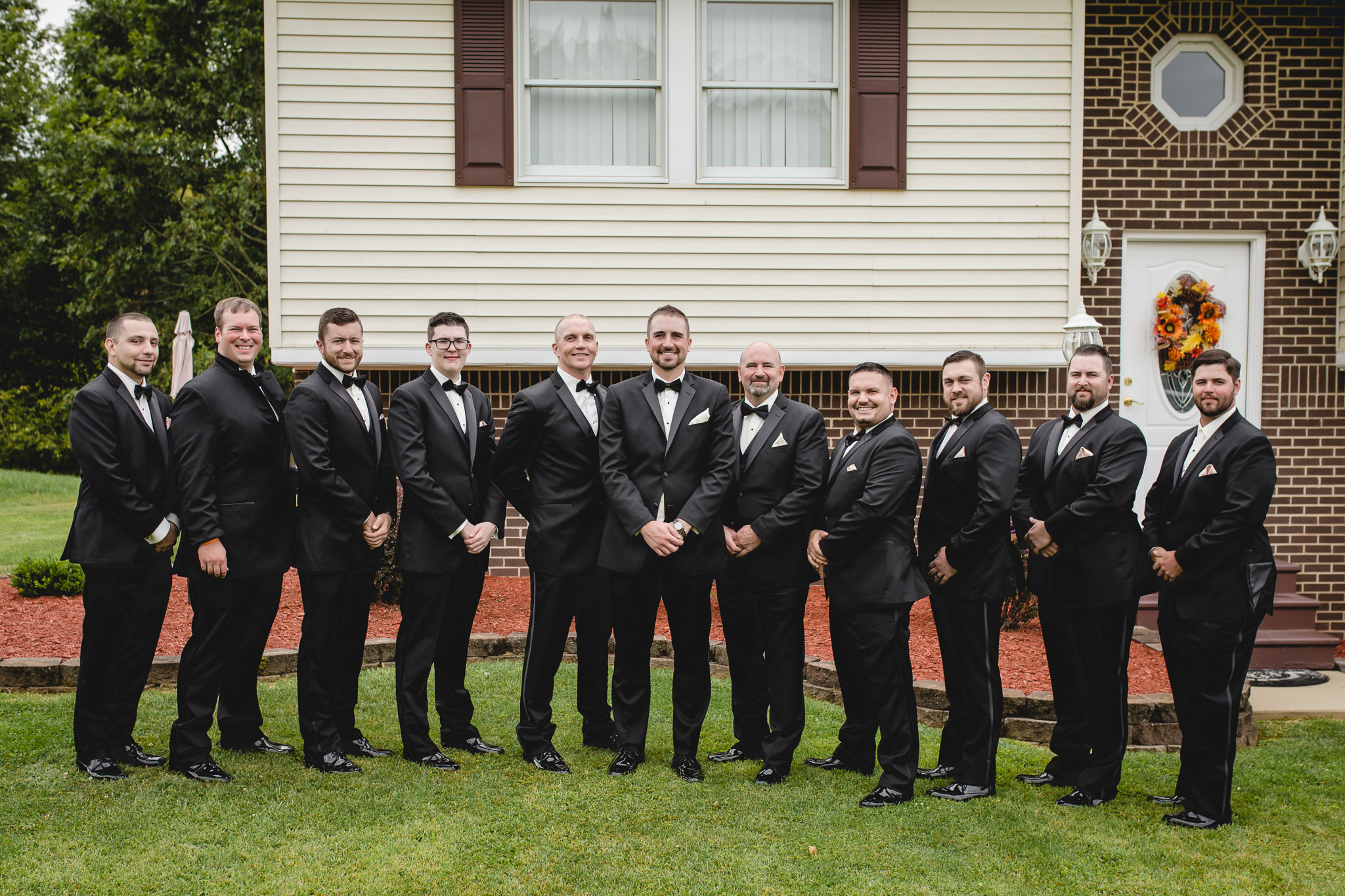 Groomsmen pose in their Rondinelli tuxedos before a Gathering Place at Darlington Lake wedding