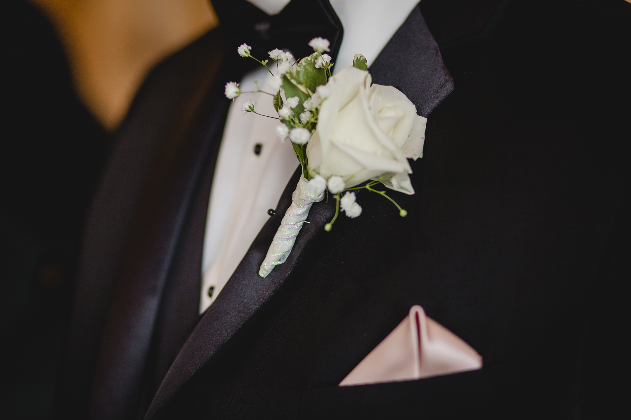 White rose boutonniere for the groom at the Gathering Place at Darlington Lake