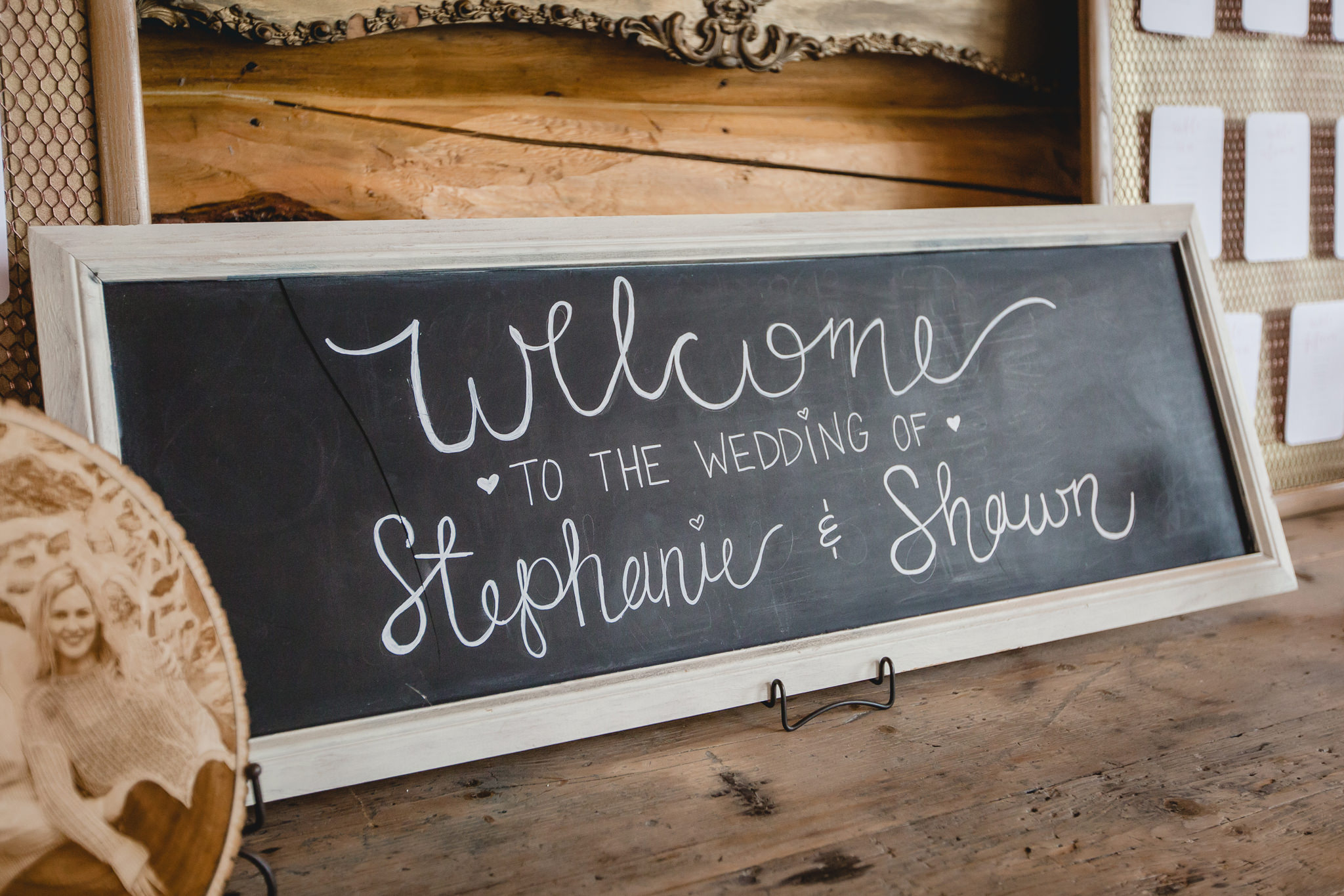 Chalk welcome sign at a Gathering Place at Darlington Lake wedding