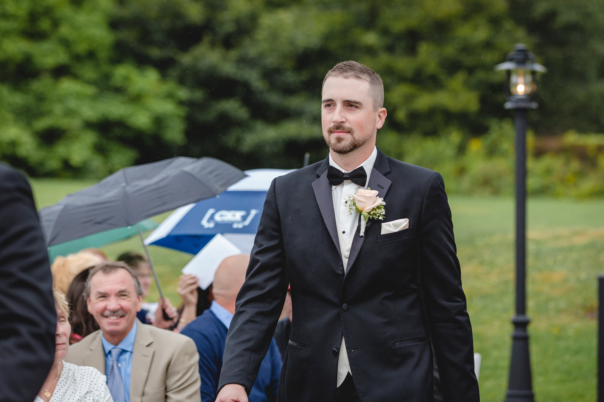 Groom walks down the aisle at his Gathering Place at Darlington Lake wedding ceremony