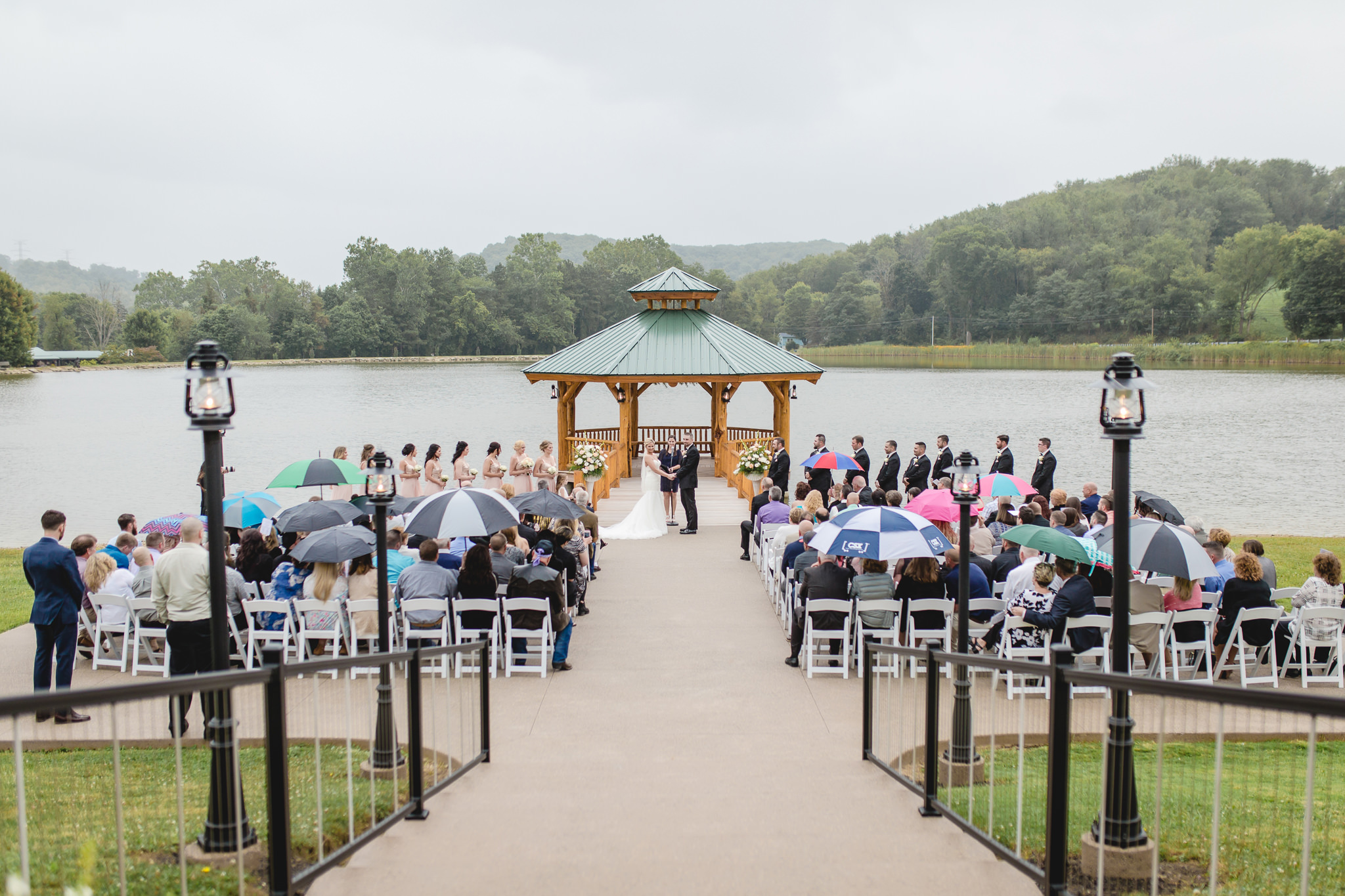 Rainy outdoor wedding ceremony at the Gathering Place at Darlington Lake