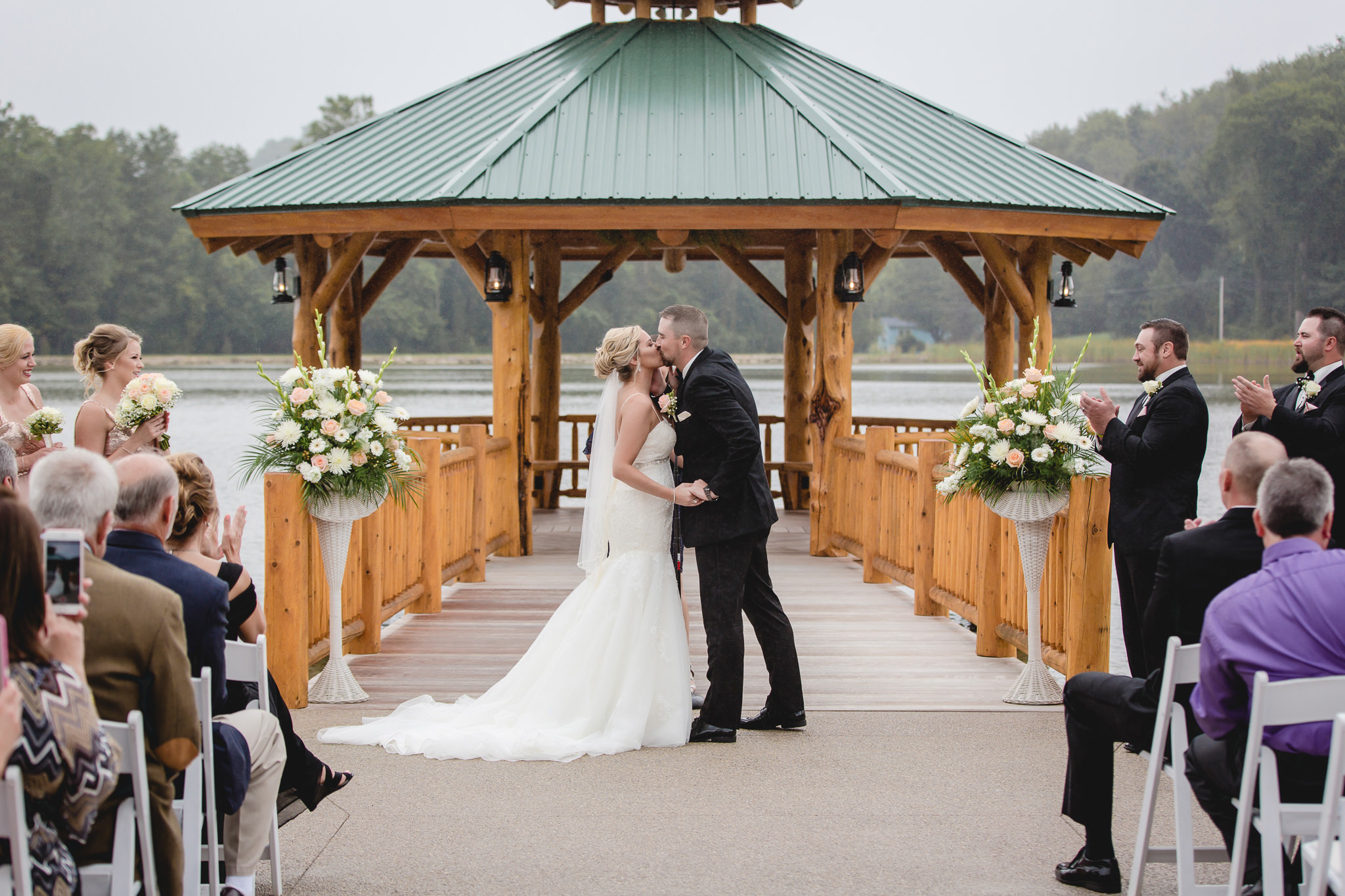 Bride and groom's first kiss at the Gathering Place at Darlington Lake