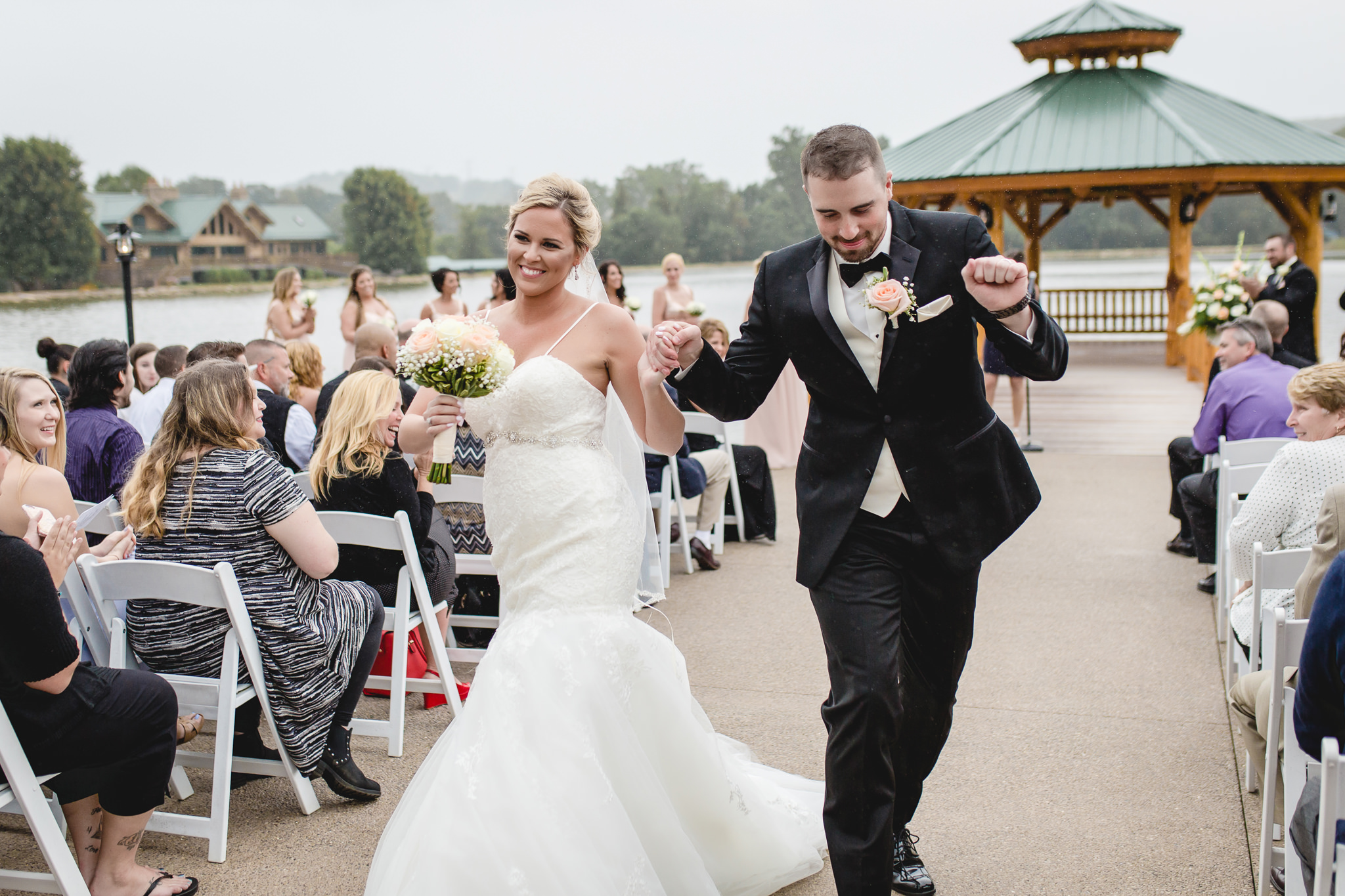 Bride and groom dance up the aisle at the Gathering Place at Darlington Lake