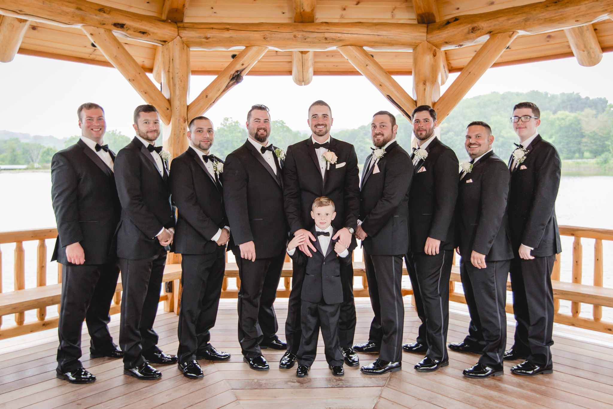 Groom with groomsmen at the Gathering Place at Darlington Lake gazebo