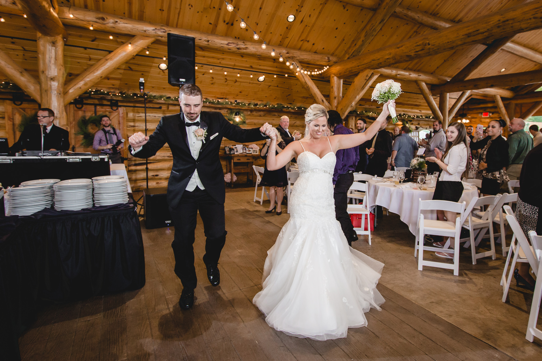 Newlyweds enter their reception at the Gathering Place at Darlington Lake