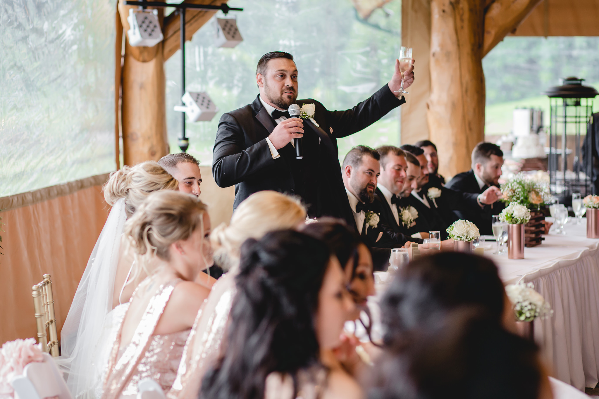 Best man toasts the bride and groom at the Gathering Place at Darlington Lake