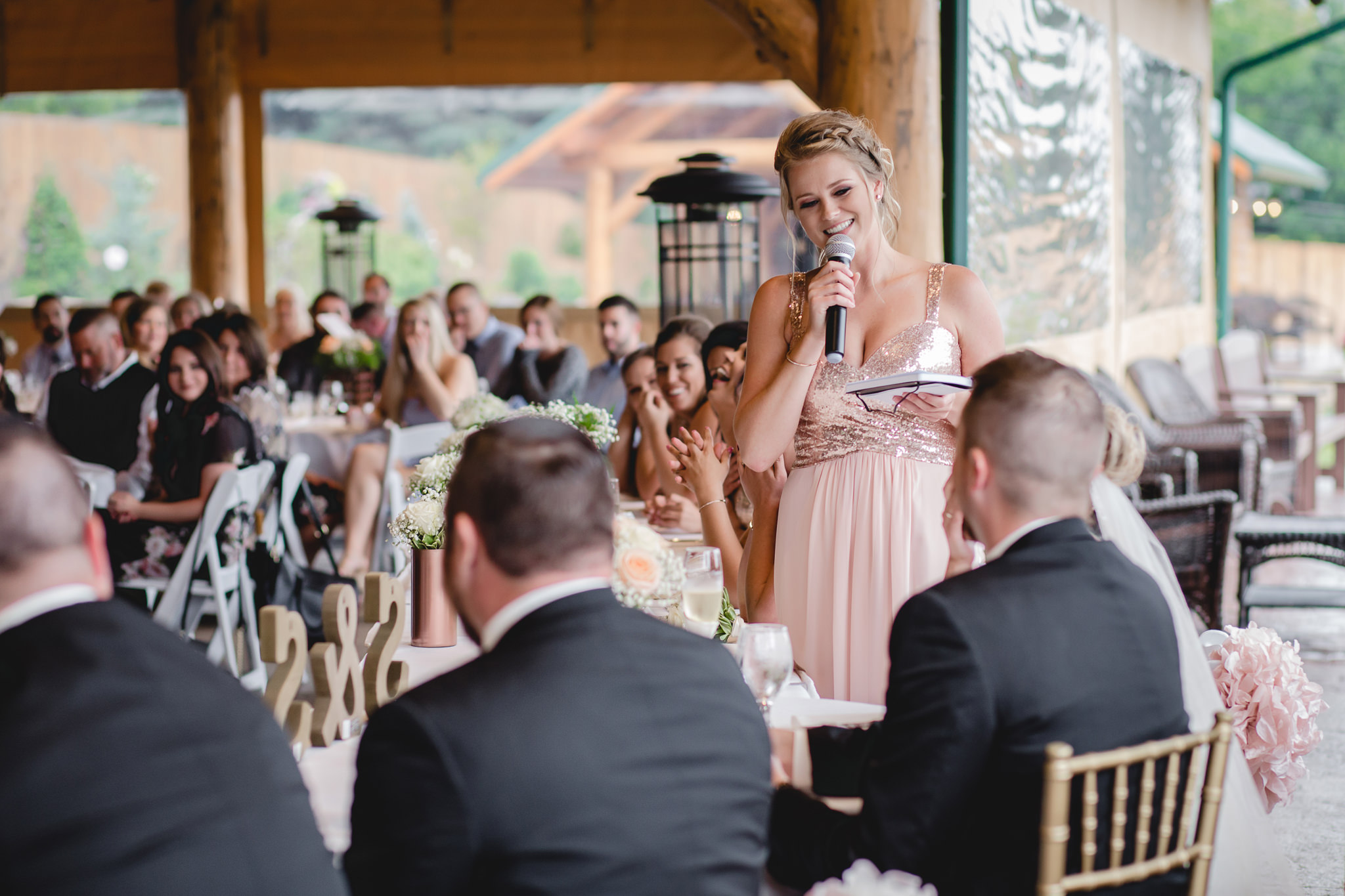 Maid of honor toasts the newlyweds at the Gathering Place at Darlington Lake