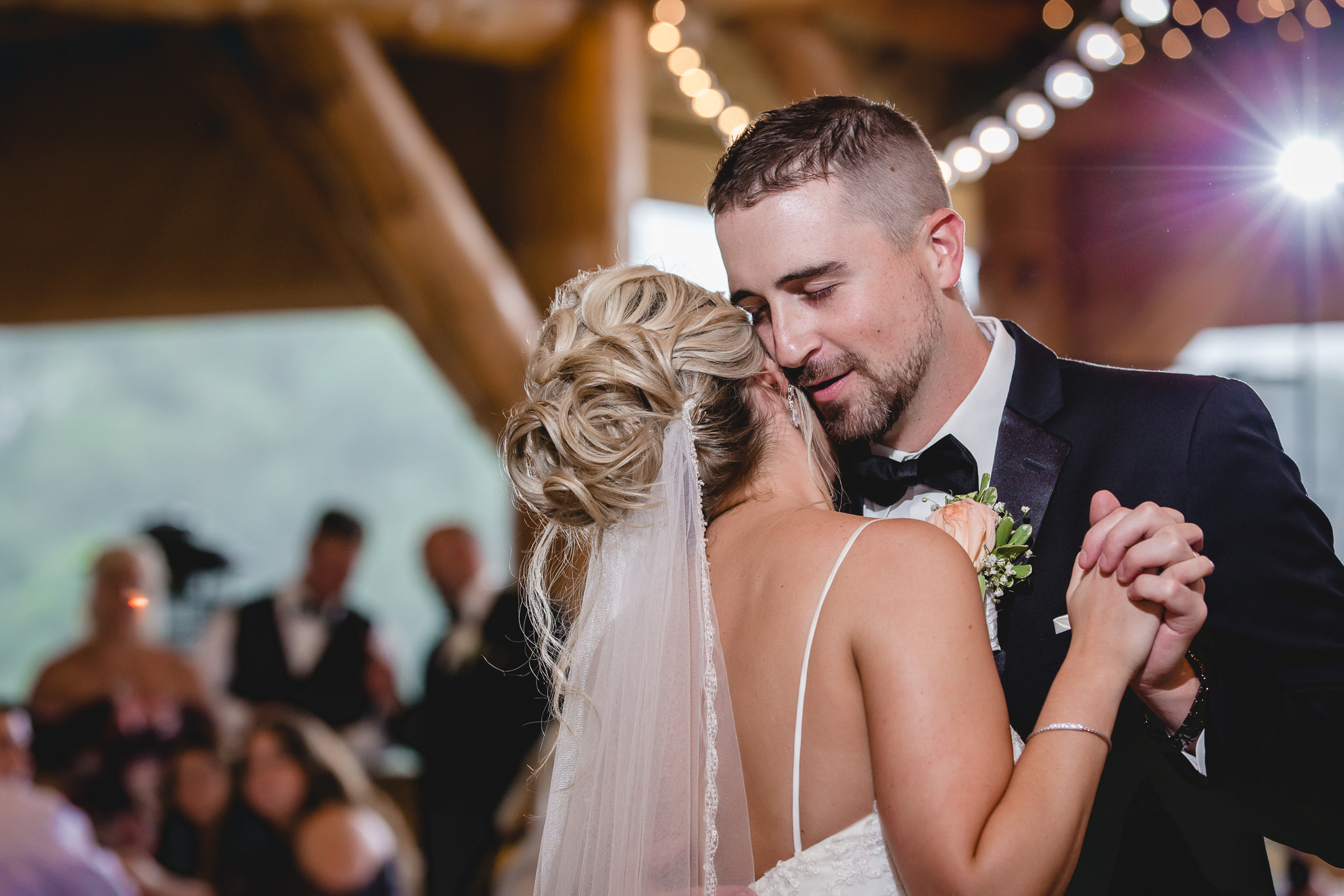 Groom sings to his bride during their first dance at the Gathering Place at Darlington Lake