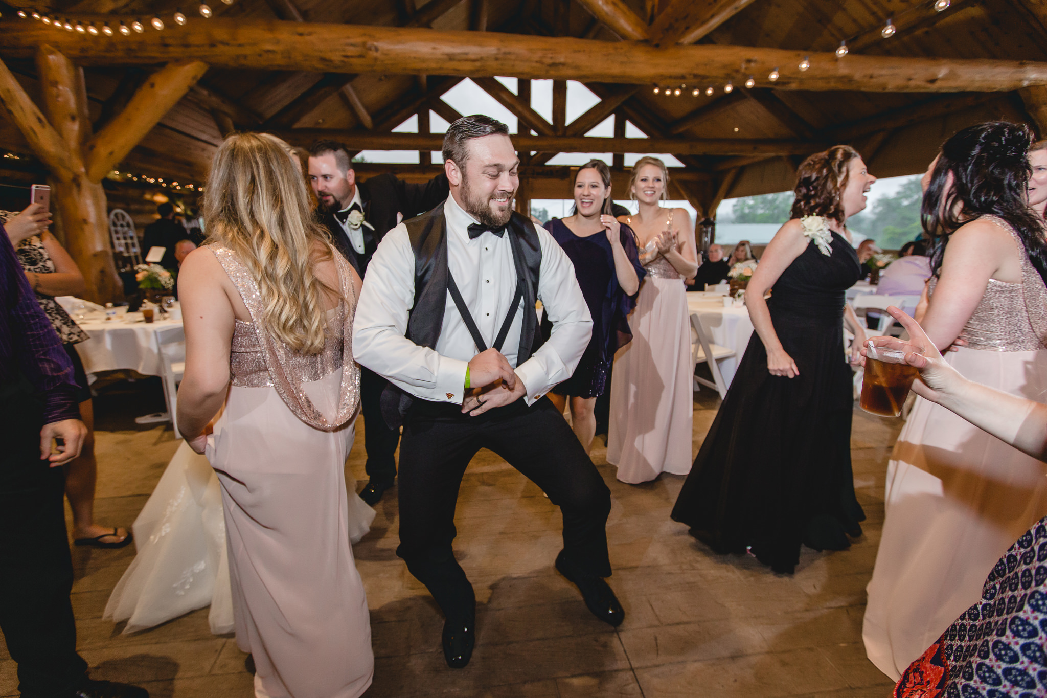 Groomsman dances at the Gathering Place at Darlington Lake