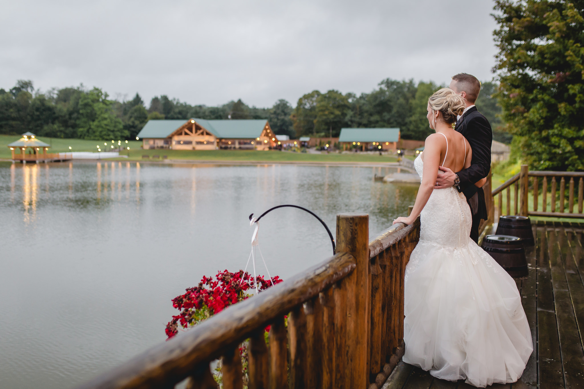 Bride and groom gaze out at the lake at the Gathering Place at Darlington Lake